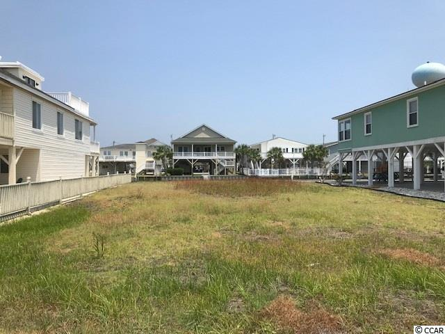This lot is cleared and  ready for you to build and enjoy all that beach living has to offer. Located on an ocean channel. There is an established sea wall. This lot is also included in the Cherry Grove dredging project.