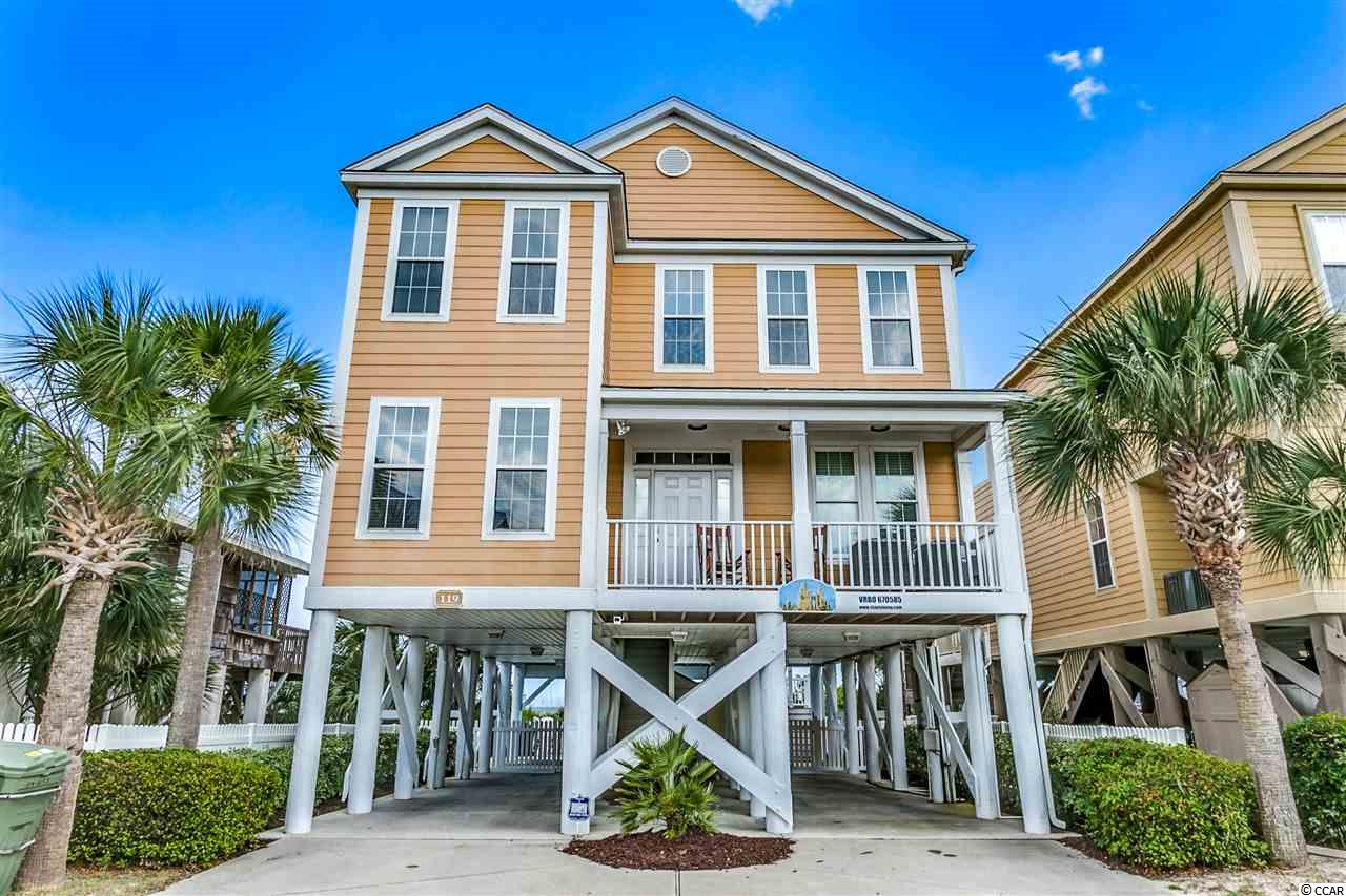 Closing scheduled for 10/18/2019. 119 North Seaside Drive is located oceanfront in the Town of Surfside Beach. The home is six bedrooms, 5.5 bathrooms, measures 2810 heated square feet and comes with a private heated pool. The interior is meticulously decorated, and the owner has made improvements that will make this raised beach house feel like a home. On the main level, there is a large oceanfront living room with half bathroom, featuring a wet bar and beverage refrigerator, dining area, that leads to a well-appointed kitchen highlighting granite countertops, stainless steel appliances, and white 42-inch cabinets. There is a formal dining room, bedroom with private bathroom, and there are covered porches on the front and oceanside of the home. Upstairs you'll find a loft living area, five more bedrooms, and three bathrooms, two oceanfront. The exterior is wrapped in concrete fiber siding, parking for six cars, enclosed shower, and fenced in yard with pavers surrounding a walk-in pool. With access from the house, the thirty foot covered back porch leads to the back yard and a private walkover to the beach, both covered in composite decking. The property is situated on a recently re-nourished beach with multiple dunes and healthy Sea Oats. Just north of the Surfside Pier you're just steps to the small downtown restaurant district and minutes to all Myrtle Beach offers. The home is currently on a vacation rental program and has a thriving income history available upon request. Why rent when you can own your very own beach retreat.