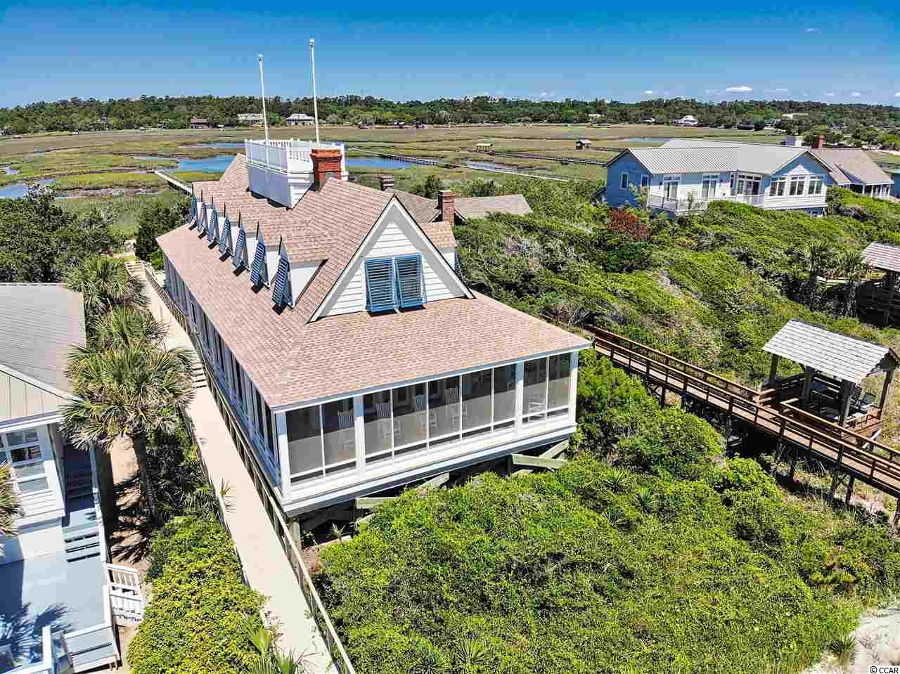 Get swept away by, Windswept. This Pawleys Island charmer is known for its exquisite craftsmanship as well as sunrises over the Atlantic Ocean and breath taking sunsets over the creek. Located right in the heart of the historic district on Pawleys Island, this home has so much to offer. From the rooftop 360 view of the island to the astounding detail in the woodwork, it's a MUST SEE! This home offers two stories with amazing spaces for you to enjoy both inside and out. With access to both the beach and the creek there is always something fun to do. Also located nearby are many quaint shops and restaurants that are exclusive to the Pawleys Island area. Whether taking in the sea breeze on the front porch or sitting creek side, this home will not disappoint. In addition, a brand new roof and hurricane shutters were just recently put on the home. Windswept is the perfect OCEANFRONT Pawleys Island home to make memories with friends and family that will last a lifetime. Oceanfront and Creek/Marsh Lot across the Street. Call today to set up a Private Tour.