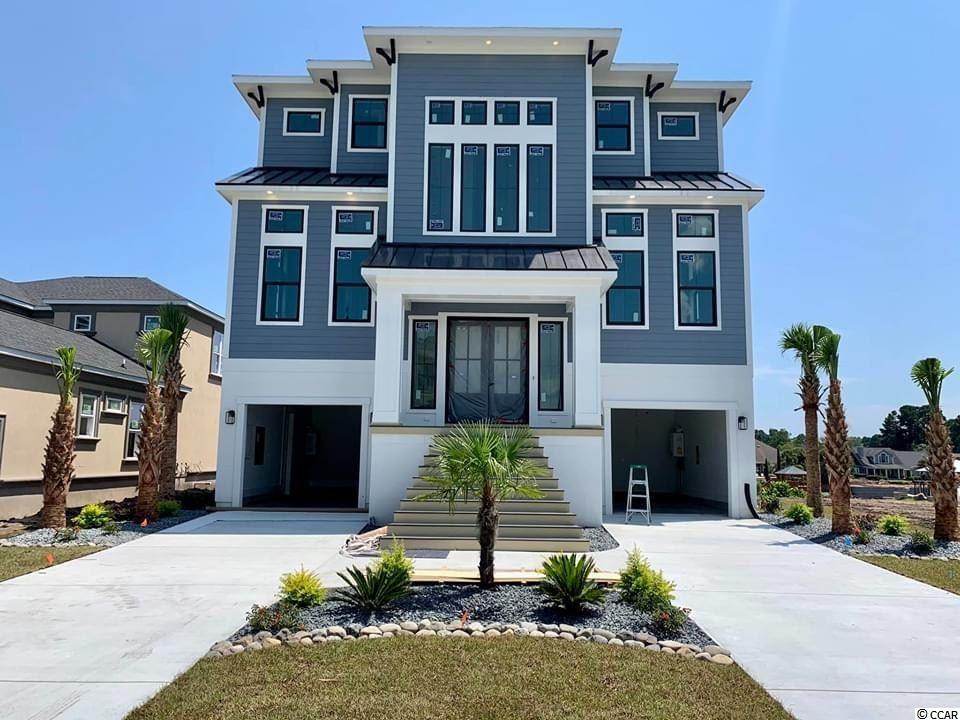 "Beautiful custom home being built on the Intracoastal Waterway in the gated community of Carolina Waterway Plantation. This home will feature 4 Bedroom, 4.5 Bathrooms, custom kitchen with 60"" cabinets, granite counters and professional grade Thor appliances. The outside features stacked stone  with board and batten, bronze windows, and custom horizontal metal railings. All the wet areas will be tiled and all the bathrooms will have tiled showers. The remainder of the house will have hardwood floors. The main floor will have 12' ceilings with incredible views of the waterway. All interior and exterior doors are 8ft tall. The house has over 1200 square feet of covered porches with pine ceilings overlooking the waterway.  Beautiful custom infinity edge pool, outdoor kitchen, see thru outdoor fireplace. The ground floor will have a open concept with a bar for entertaining, 4 panel sliding glass doors out to the pool, and an area for a designated theater.  An optional dock, and boat lift can be included for an additional amount. The community also has private boat storage, community pool, playground, gazebo overlooking the waterway, tennis courts, boat launch, and it's a gated."