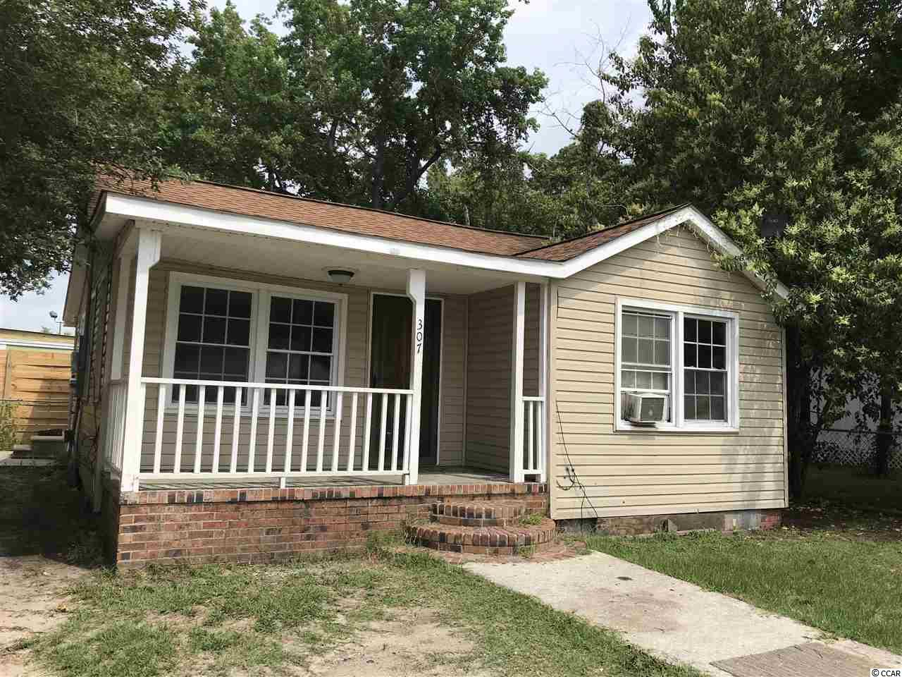 House is located on land zoned General Commercial just off of Highmarket Street in city limits. Can be used as home or office. This home is currently being used as a rental.