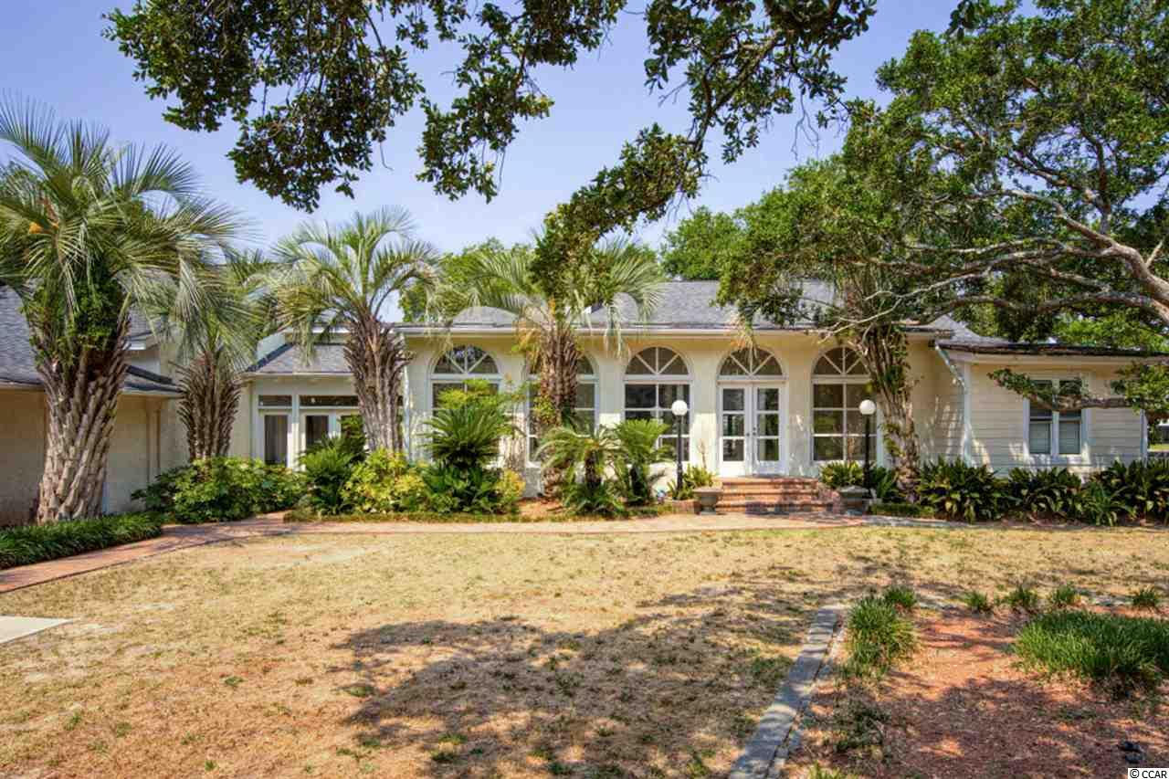 Public Remarks:  This fixer-upper Is truly a diamond in the rough. This beautiful six-bedroom four bath home located in The subdivision of Mount Gilead in the heart of Murrells Inlet.  This beautiful waterfront property is One of the largest lots in Mount Gilead at 110 feet wide.  Amazing view of the Murrells inlet marsh from both back balconies and your private dock. This home has a large backyard including a private saltwater pool and Jacuzzi along with a spacious entertainment area.  When you first walk into the home you are greeted by recently updated   Pearl white marble flooring.   Entering the main dining room which opens into the living area.  You are greeted by a massive gas's brick fireplace which lines your entertainment area. The living room has recently had updated wood floors installed as well.  The kitchen has granite countertops. With plenty of space for every night dining. On the far side of the home there's a mother-in-law suite separate kitchen upstairs bedroom with balcony.  Which has close access to the garage and laundry area.  This home does need updates and maintenance.  This Home is priced so that someone can come in and give this home the care and updates it needs. Possible investment property.   Come see this property today you don't want to miss this steal!