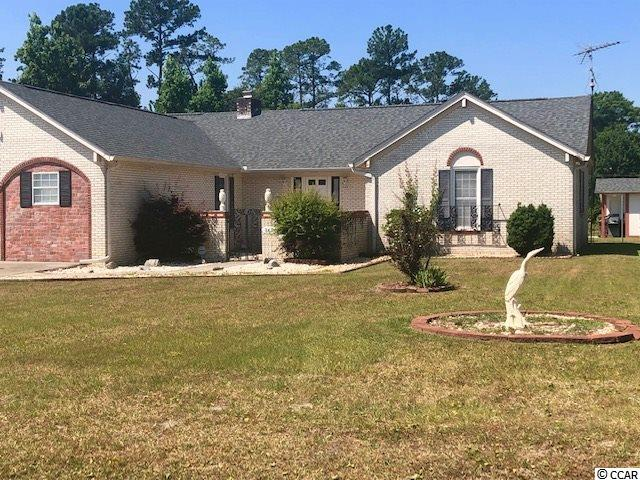 Large, rambling, brick ranch home on a spacious 0.78-acre double lot off of Hwy. 501 Myrtle Beach. Westwood Estates is a unique development with large lots and approximately 35 homes where neighbors tend to stick around. 4305 Fernwood boasts a large corner lot, two separate driveways, a detached shed and workshop, backup septic and well water; property is currently serviced by public water and sewer. Home has been immaculately maintained and features 5 bedrooms, 2 baths, a spacious kitchen and great room with separate but open dining room entertaining space. The master ensuite features a large walk-in alcove tile shower with built in shower seat.  Extremely spacious kitchen opens to the great room where you'll find a centrally located gas-log fireplace surrounded by gorgeous hardwood flooring. The master suite, second bath, and two bedrooms are on the right side of the home while the two additional bedrooms and separate piano/sitting room are situated on the right side of the home behind the kitchen area. Gather with family and friends in this open concept kitchen, living room and dining room that opens out to your spacious 12 x 32 screen room across the back of the house facing the backyard driveway, serene woods, and backyard. A perfect lot for adding an in-ground pool, privacy fencing, and outdoor kitchen. This home, with a double lot, is a great space for entertaining and hosting friends. The indoor and outdoor spaces lend themselves to a feeling of privacy and open space that's difficult to find in Myrtle Beach and at such a great price! This neighborhood is a hidden gem and homes are rarely are on the market! You can't go wrong with this home and an added bonus is the nearly new HVAC, roof (home & workshop), dehumidifier in the sealed crawlspace, all replaced within the last 3 years and NO HOA! Make an appointment today to see this unique space and bring your imagination - there's so much potential to create your own personal oasis. Place this home on your sho