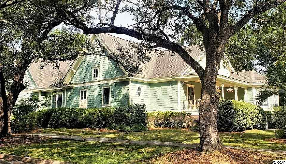 OPEN HOUSE 1/18 from 12-3pm and 1/19 from 1-4pm * FRESHLY PAINTED INTERIOR (and garage!) This Lowcountry BEAUTY is ONE OF A KIND, as its surrounded by the much older Historic Georgetown Homes but this Home was built in 2004 *Beautiful CORNER LOT here with private rear yard. Majestic oak trees line the sidewalks and give shade where needed. You will love walking downtown to be entertained or to shop and dine on the waterfront! This southern charm lies quietly on a well appointed larger lot,  'just 2 blocks to the Harborwalk. IF you fish or boat, you will enjoy Winyah Bay, where many rivers come together for fresh and saltwater catches! A true front porch for rockin' and mature landscaping provides complete privacy in the backyard and side. Numerous oaks, bountiful shrubbery and blooming azaleas live on the property. Just mulched * Inside you will find the wide open concept most seek and this Home is completely Handicap accessible so this could be your forever Home! Warm cherry flooring, crown molding is literally throughout, high baseboarding, chair rail, flat ceilings with recessed lighting and Charleston color scheme makes this place so inviting and cozy. Large Carolina Rm overlooks the backyard beauty and the birds come and go all day. The Owners suite is spacious and the light pours in - sep. walk in closets and a bathroom that will blow your mind in design :) Bedroom 2 is also on the mail level near the half bath, office area, laundry room and exit to garage or entrance upstairs to Bedroom #3. No space was wasted as you will see (especially upstairs where various closets and large storage areas were added). I love this room because it's so sunny and looks down over the gorgeous backyard and its has big closets and a great bath layout. If you have wanted to be in the Historic section of Georgetown, but were not needing (nor wanting) a Home built centuries ago, then THIS Home is for YOU ~ BRING YOUR OFFER
