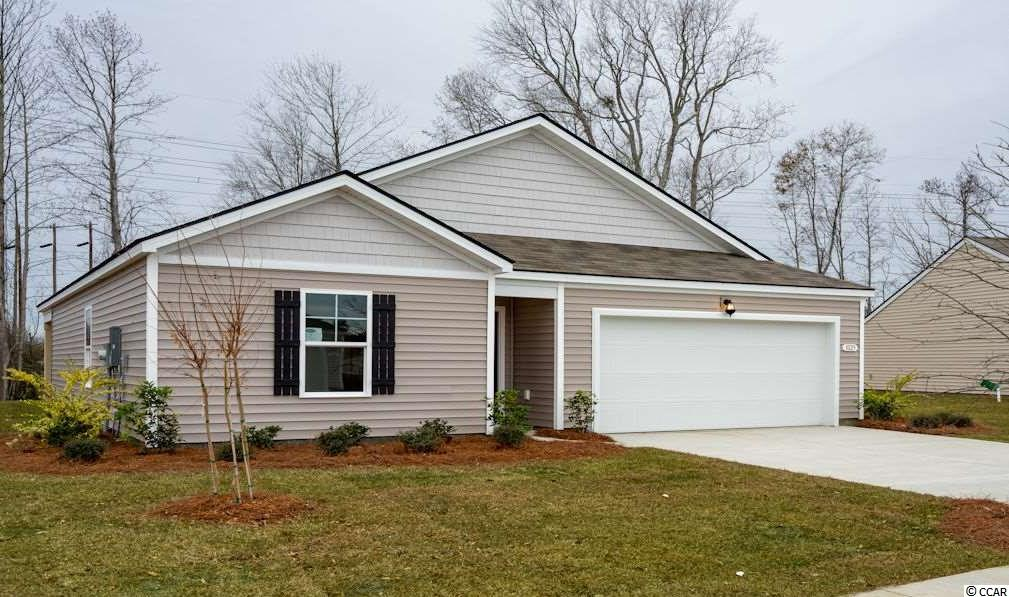 The Kerry is a one level home with 3 BR 2 Bath, 1476 heated sq. ft. plus a 2-car garage with an open floor plan that features a comfortable kitchen with a huge island which opens to your large living/dining room. Granite counters, pantry and stainless appliances. Low maintenance luxury floating vinyl wood plank floors throughout main living room, kitchen, both baths and the laundry room. The owner's suite is located off the back of the home and offers a large walk-in-closet and Master Bath with 5 ft. walk-in shower, and cultured marble vanity top. Oak Glenn features large home sites with a minimum of 20 ft. of separation between homes. The community is located within minutes to Historic Downtown Conway, shopping, restaurants, and the River Walk. Pictures are of the same plan model home and are for illustration purposes only. Home and community information, including pricing, included features, terms, availability and amenities, are subject to change and prior sale at any time without notice or obligation. Square footages are approximate. Pictures, photographs, colors, features, and sizes are for illustration purposes only and will vary from the homes as built. Equal housing opportunity builder.