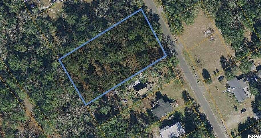 Great place to build your Dream Home.  Property has several Large Oak Trees and is with in minutes to the ocean and steps to playing golf. Mobile Home does not convey.