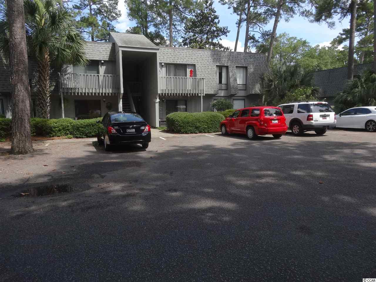 Great investment deal in Salt Marsh Cove for a rental property, personal home, or vacation home.  2 Bedroom 1 1/2 bath unit on second floor with balcony. Many updates including NEW commercial grade laminate flooring throughout, granite countertops, stainless steel appliances, and stackable washer and dryer. Nicely furnished with 2 queen and 1 single bed (along with pull out sofa bed). It is move in ready (includes all linens, dishes, pots/pans, small appliances, etc).  Salt Marsh has a beautiful pool, dock, and boat storage, Basic internet is included in the monthly regime as well as the water bill. This condo is only 5 minutes to Litchfield Beach.