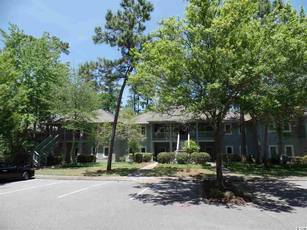Pristine Teal Lake Charmer with views of the Lake and walking distance to one of Tidewaters many swimming pools!  This unit has carpet and tile flooring,water heater 2018, HVAC unit 2019  washer dryer within past year and very well maintained  fresh look.  Tidewater is a gated community with guards at the gate 24/7 ,multiple pools, clubhouse, firtness center,tennis courts,public golf course,restaurant within community and its own private Beach Cabana.  Literally minutes to Cherry Grove Beach!!!!!!! Last but not least great shopping in N Myrtle Beach and restaurants galore!!