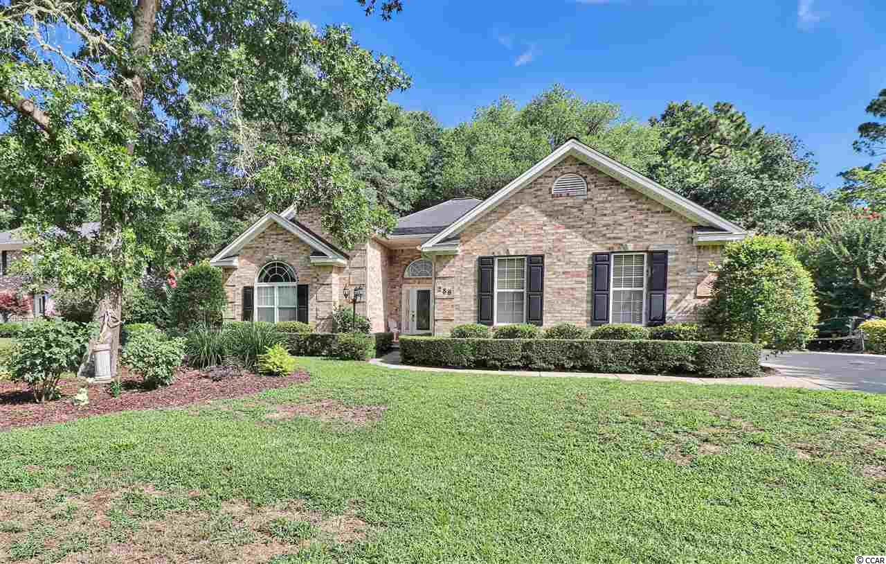A must-see, all brick, one level, custom built home with a home warranty! Located on the golf course in the quiet neighborhood of Litchfield Country Club, with a voluntary HOA. The spacious, open floor plan has 3 bedrooms and 2.5 baths. Most floors replaced and rooms freshly painted December 2019. The den/office can be converted into a 4th bedroom which includes custom built-in cabinets and lots of windows. The great room also has custom built-in cabinets plus a gas fireplace. The large, open kitchen has granite counter-tops, stainless appliances, work island, breakfast bar, breakfast nook, custom cabinets with roll-out drawers and in and under cabinet lighting. Off of the kitchen via sliding glass doors is a pergola covered patio that is perfect for grilling out. The master bedroom includes a ceiling fan and large walk-in closet. The master bath includes two sinks, a walk-in shower, Jacuzzi tub, linen closet and even a ceiling fan. Relax in the living room/sitting area or the 13' x 20' screened porch with vaulted ceilings, ceiling fans and tile floor. Attached is an outside storage for yard equipment, etc. Home includes a security system and a sprinkler system with a lawn well. 2-car garage with shelves and stairs to the attic. Close to beaches, restaurants, shopping, schools, golf courses and much more. Historic Charleston is approx. 75 miles/1.5 hours, Historic Georgetown is approx. 15 miles/25 minutes and Myrtle Beach is approx. 20 miles/30 minutes. Square footage is approximate and not guaranteed and should be verified by buyer.