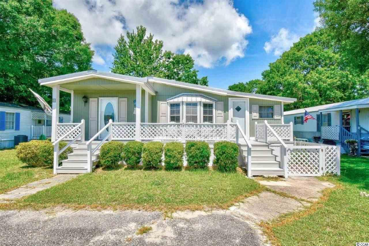 This immaculate, 3 generous -sized bedrooms, 2 bath, well maintained home is in Captain's Cove, a quiet community for folks 55+. Located close to beaches, famous SC seafood restaurants,  Brookgreen Gardens, and too many other coastal attractions to list.   This home is in a great location-- directly across the street from the clubhouse and swimming pool where you'll find lots of activities to enjoy.  This home features two decks, front and back.  Appliances and some furniture transfer, as desired.  The kitchen has cabinets galore, beautiful bay window, and new dishwasher.   Large storage shed in back of the property (leased lot).   Neighborhood is extremely pet friendly.