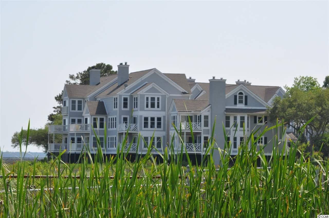 WELCOME TO THE LOW COUNTRY LIVING OF MURRELL'S INLET!! THIS IS A RARE OPPORTUNITY TO OWN ONE OF THE MOST BEAUTIFUL VIEWS ALONG THE GRAND STRAND!! THIS BEAUTIFUL, DIRECT MARSH FRONT TOWNHOME BOASTS 2 BEDROOM, 2 1/2 BATH, ALONG WITH 2 SUNROOMS THAT HAVE DIRECT VIEWS OF THE GARDEN CITY POINT AND MARSH INLET!! WATCH THE 4TH OF JULY FIREWORKS OVER MURRELL'S INLET FROM THE COMFORTS OF YOUR BALCONY!! ENJOY YOUR MORNING COFFEE WITH THE MOST BEAUTIFUL SUNRISE OVER THE INLET!! RELAX AND TAKE IN THESE INCREDIBLE VIEWS THAT STRETCH FROM GARDEN CITY TO HUNTINGTON BEACH STATE PARK! IN THE WINTER MONTHS, WARM UP NEXT TO YOUR WOODBURNING FIREPLACE WHILE WATCHING THE FISHING BOATS COME IN! THE BLUE HERON IS CLOSE TO BROOKGREEN GARDENS, HUNTINGTON BEACH STATE PARK, ENTERTAINMENT, AMAZING RESTAURANTS, AND OF COURSE SOME OF THE BEST FISHING AROUND!! PUT THIS HOME AT THE TOP OF YOUR LIST!! THIS SOUTHERN CHARM WON'T LAST LONG! MOTIVATED SELLERS!!!