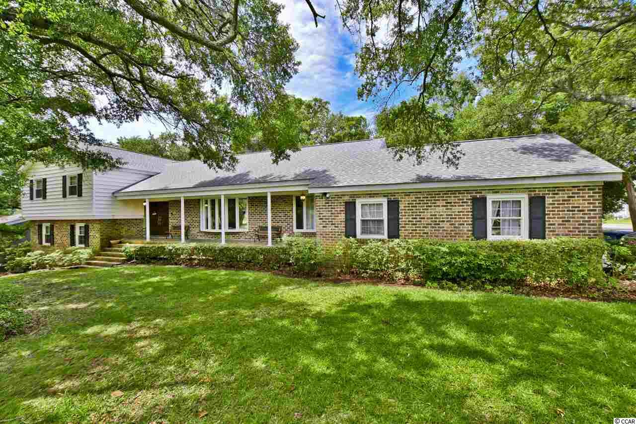 ONLY ONE BLOCK TO THE BEACH!!! YOU CAN'T FIND A BETTER LOCATION! INCREDIBLY RARE OPPORTUNITY TO OWN THIS WONDERFUL 4 BEDROOM, 3.5 BATH IN LONG BAY EXTENSION WITH NO HOA. NESTLED ON HUGE CORNER LOT WITH MATURE OAKS AND FEATURING NEW ROOF 2017, NEW GUTTERS 2017,NEW HVAC SYSTEM 2017 AND NEW CARPET 2017.  ALSO OFFERING FORMAL DINING ROOM, 2 FIREPLACES, WOOD FLOORING, LAUNDRY ROOM, WET BAR, BALCONY, LARGE PATIO, 2 CAR GARAGE AND SO MUCH MORE! THIS GEM SITS ON OVER HALF AN ACRE AND IS PARTIALLY FENCED IN. CLOSE TO ALL THAT MYRTLE BEACH HAS TO OFFER INCLUDING GREAT SHOPPING, DINING, CHAMPIONSHIP GOLF AND NIGHT LIFE. FANTASTIC, EXPANSIVE PROPERTY AT A TRUE VALUE!!!