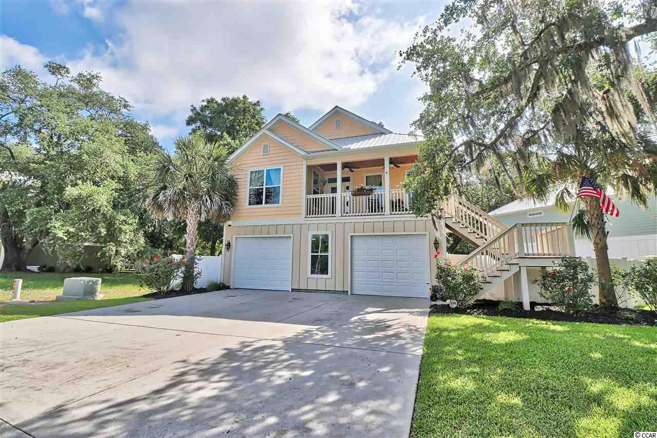 """This beautiful, inlet-view home is located in the heart of Murrell's Inlet with a concrete boat ramp directly out of the front door. This wonderful 4 bed/3 bath like-new home was constructed in 2013, and consists of a spacious coastal-style floor plan with cathedral ceilings and gas log fireplace in the large family room, multiple storage closets, and upgraded wood and tile floors throughout. The semi-professional kitchen features upgraded raised panel wood cabinetry, granite counter tops, stainless appliances, and a Hibachi-style commercial cooktop griddle. The spacious master suite features a custom tile shower, double vanity sink, granite counter tops, huge walk-in closets, and a private screen porch with a bed swing. Two bedrooms are located on the lower level with a full bath, perfect for hosting guest. Other features include a plethora of additional storage cabinetry, an enormous 2-car attached garage with solid garage doors, electric openers, security system, vinyl privacy fencing, and a lower level covered porch. The home is located in the desirable Flaggpoint community, which is comprised of just 13 lots overlooking beautiful Murrells Inlet. Mature angel oaks and palm trees line curb and gutter streets, and a private boat ramp provides access to the water. Murrell's Inlet, known as the seafood capital of South Carolina, features both casual & fine dining, night life, and live music along the famous Inlet front """"Marshwalk."""" Many of these eateries are accessible by golf cart or boat ride from this home. Other area attractions include the award winning Brookgreen Gardens, Huntington Beach State Park, Atalaya Castle, and Pawley's Island boutique-style shopping. If you're looking for a like-new, ready to move into, inlet home at a VERY attractive price, this is it. Move in, get yourself a golf cart and boat, then drop off the radar! Call today to schedule a showing!"""
