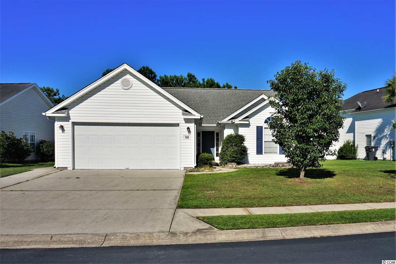 Located in the convenient Mallard Landing Village, this home has great curb appeal and is less then 5 minutes from the beach! As you enter through the front door invited to the openness of a Living Room/Dining combo floor plan with vaulted ceilings. Gather comfortably in a generous size Kitchen with breakfast bar/breakfast nook area. Be greeted by the early sunrise in the Carolina Room while looking out over the pond. This home features 3 Bedrooms and 2 Full Baths. The Master Bedroom is located in the rear of this split floor plan and the other 2 bedrooms are in the front of the home. Ceiling fans in all bedrooms, living room and Carolina Room. The Master Bath has a full size shower and 2nd bathroom is outfitted with a shower/tub combo. Attached spacious 2 stall garage heated with washer and dryer. As an added bonus, a cozy screened in back porch with a ceiling fan! This price reflection will enable you to add your own personal touch to be creative inside in need of some TLC cosmetic updates, at this PRICE do not miss your opportunity to call this your dream beach home today! The potentials are endless!!
