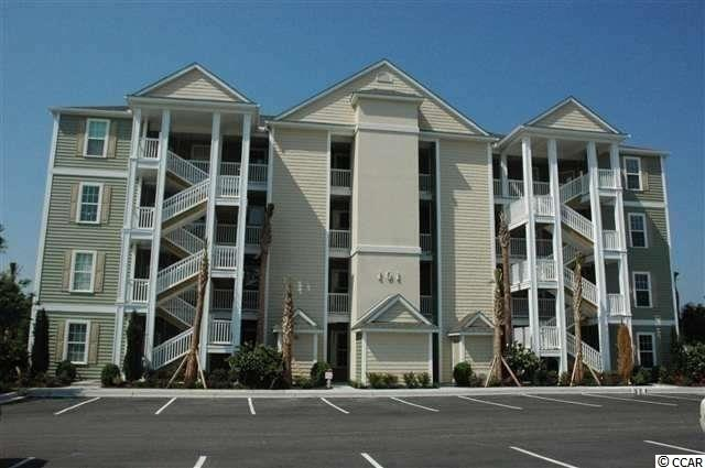 MOVE IN READY. Located in one of the most successful condo developments in the Myrtle Beach area, this second floor unit is a 2 bedroom 2 bathroom beautiful condo in the very popular Queens Harbour! Building has an oversized ELEVATOR to all floors, outside storage, split bedroom floor plans with entry to the Master Suite from the Family Room, 9' smooth ceilings and a screen porch. The location is superb with shopping, dining and recreation steps away. The amenity package includes a resort style swimming pool with club house and conveniently located picnic areas with barbecues. Move in Ready with tile flooring in the living room/dining room/kitchen and hallway. Tile flooring in both bathrooms and laundry room. Linen white cabinets with Caledonia granite counter top in kitchen. Crown molding in the living room, dining room, hallway and kitchen. Crown molding in Master Suite.