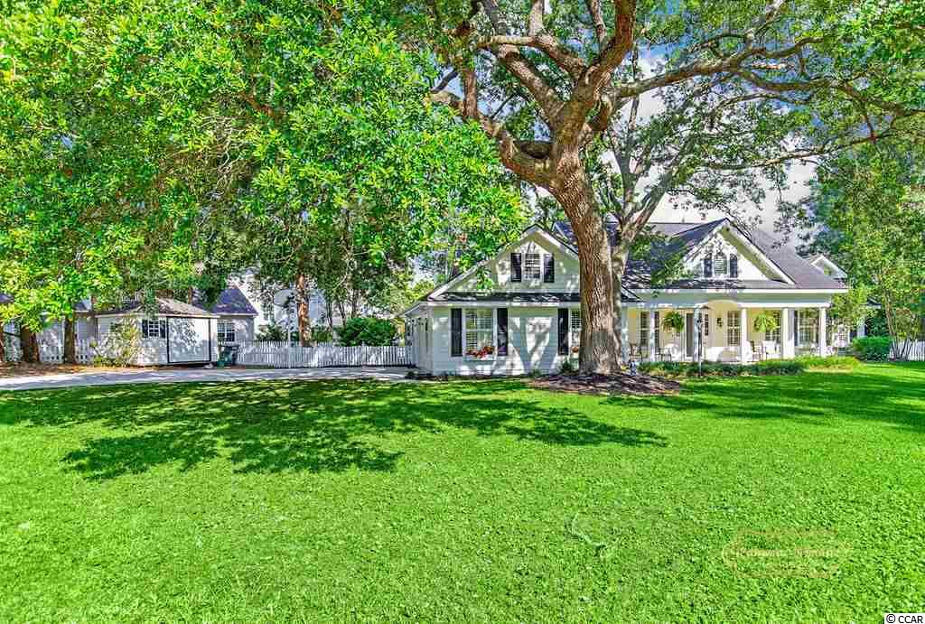 Welcome to the southern charm you've been searching for. Have a seat on the covered front porch of this sprawling ranch home with it's majestic Live Oak that invites you to enjoy it's beauty and shade. The interior opens up with natural light from the windows and a feeling of spaciousness from the cathedral ceiling. New flooring has been installed in the living room, dining area and master bedroom. Plantation shutters throughout, lots of storage, large walk in closet in master en suite are just a few of the plusses. HVAC was replaced last year, roof is still under warranty, walls and ceilings have been freshly painted. Riverside is an Intracoastal Waterway community, east of Hwy 17 and this gorgeous home is just a short walk away and a golf cart ride to the shores of the beautiful Atlantic!