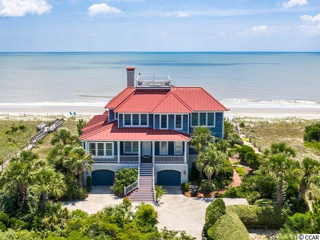 For your dream view come look at this beach home on DeBordieu Boulevard's prime location. Escape from the city and breathe fresh air while enjoying your large Lowcountry porches. There is plenty of room for your family in this six bedroom, seven full and one half bath home. The master bedroom is on the main level with guest bedrooms above with their own inviting living area. The owners have continued to enhance and care for the timeless home representing the very best in design, materials, and quality construction with a list of updates. The kitchen is a cook's dream and looks out onto the spacious living area. The porch is very wide and spacious with arrangements for outside dining. The owner's office provides space for work and privacy. The ground level is well finished and affords ample space for vehicles, boats, golf carts and beach toys. There is enclosed storage and 2nd laundry room in the garage area. Enjoy majestic views from the widows walk on top of the home. This is truly a remarkable property for the discerning family looking for oceanfront privacy as well as the very best DeBordieu has to offer. DeBordieu is a year round resort like community with a neighborhood feel. Enjoy cycling, golf cart riding, wildlife viewing, boating, golf, tennis and dining all within the gates of DeBordieu.