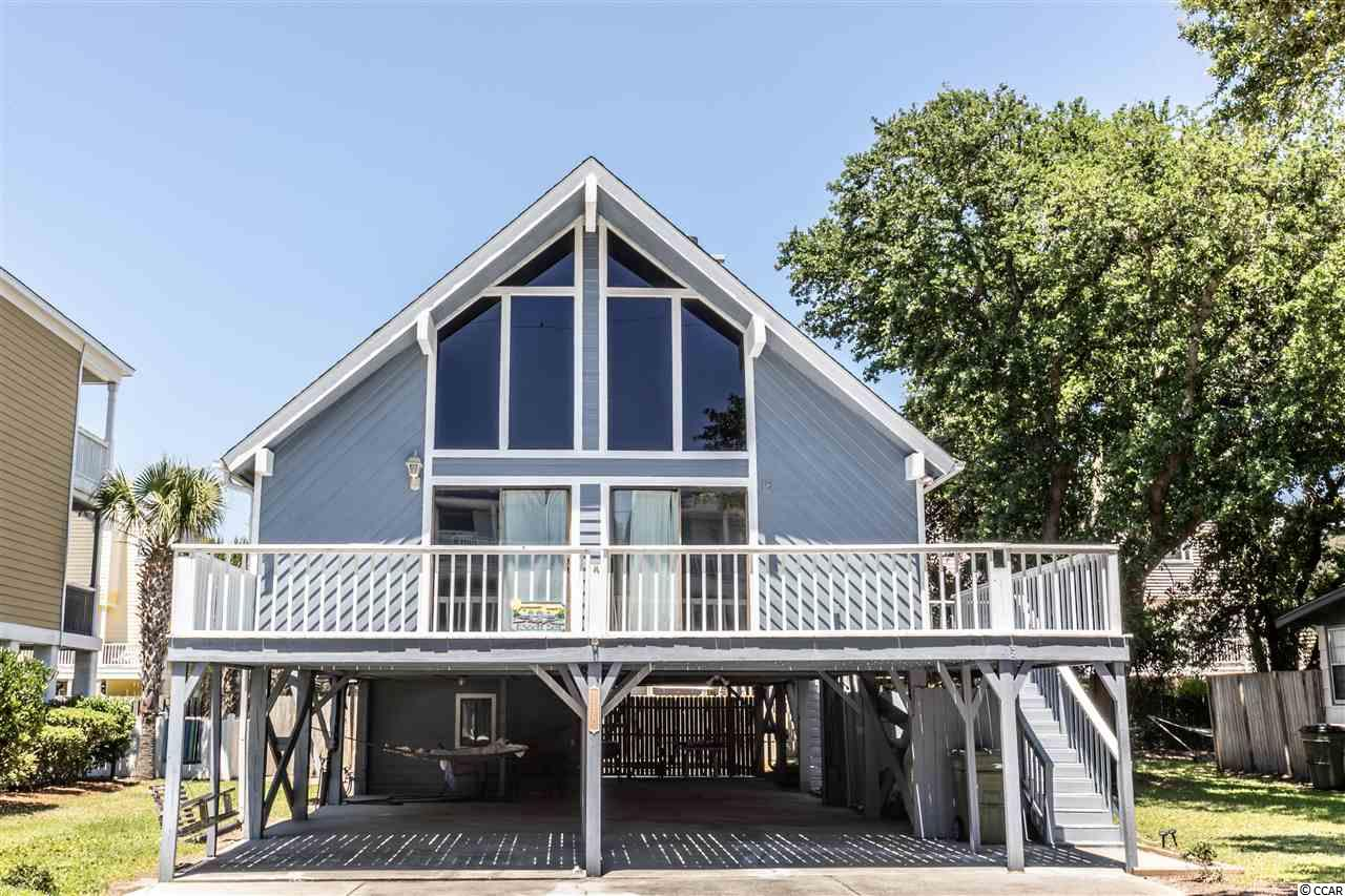 Here is your chance to own a beach house within walking distance of the ocean! This home would make a perfect investment property or primary residence. Large windows in the living room let in plenty of natural light, leading out to a large front deck. Other features include high vaulted ceilings, plenty of space for parking, in-ground pool and much more. Storage area under the home for all your pool equipment. All with no HOA! Conveniently located in Surfside Beach, close to shopping and entertainment; this home is a must see. Schedule your showing today! All information is deemed reliable but not guaranteed, buyer is responsible for all verification.