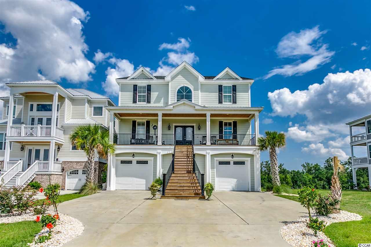 Beautiful custom home on the Intracoastal Waterway in the gated community of Boardwalk on the Waterway. Custom kitchen with granite counters. All the wet areas are tiled and all the bathrooms have tiled showers.  The ground floor features a massive garage that leads to the outdoor entertainment area with a inground pool, spill over spa, and a private dock with a boat lift. Elevator and natural gas tankless hot water heater.  The community also has private boat storage, 5 day docks, boat launch, security and a 2500ft boardwalk along the Intracoastal Waterway.