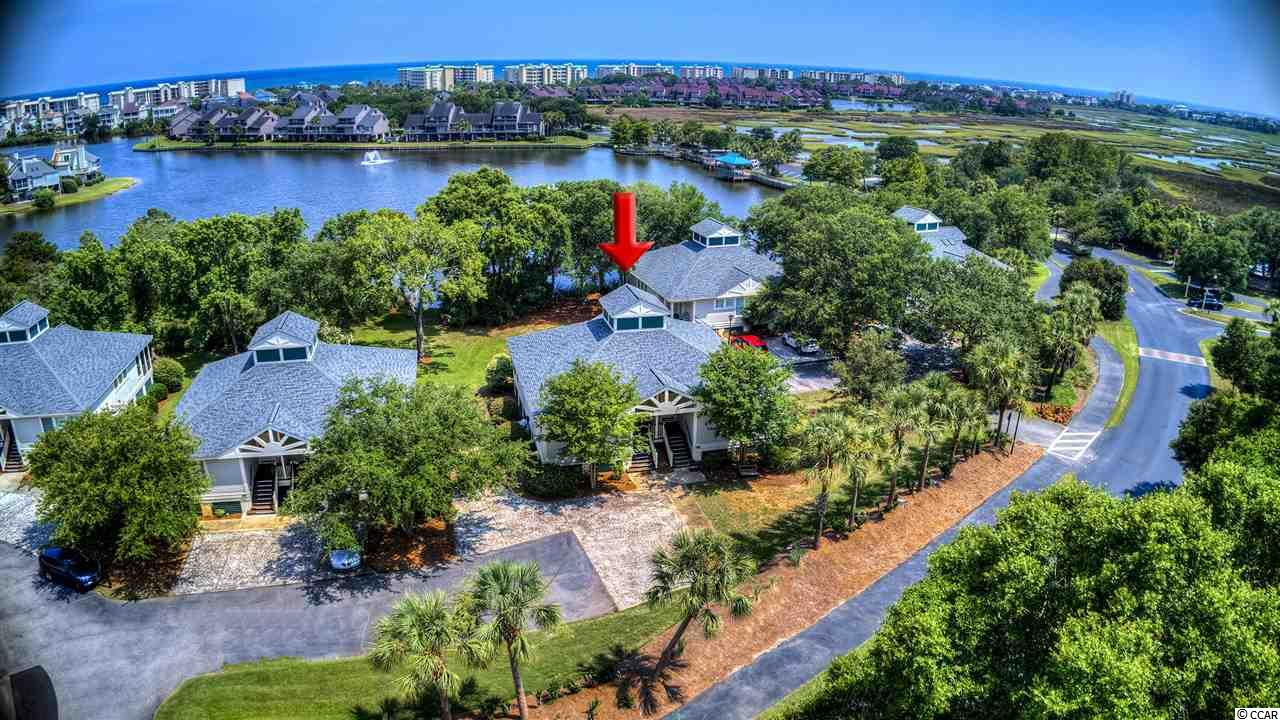 """A beautiful direct waterfront """"Litchfield by the Sea"""" unit with some extra room outdoors for enjoyment! Not only does 12-A come with a fantastic on-going rental book, it's also one of the few buildings with ample common property off the rear screened porch to enjoy what you come to the beach to enjoy (your time outdoors!) Let the kids or grand-kids wear themselves out while you kick back and relax....how nice is that?? Although the rear of the property is nice an open, its not too far back to enjoy the direct water views as well. It's really a one of kind type of location! The interior features hardwood flooring, various updates, and a great floor plan to suit many different taste & interest. PETS ARE ALLOWED!!"""