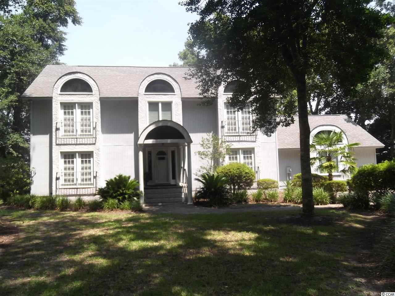 This is a very nice home in a very nice waterway community. Directly on the Intercoastal Waterway with great views. Watch the boats go by as you sit on a very large deck; also waterway views from the back of the house. Bulkhead put in a few years ago with a boat slip. This home is not in a flood zone; no flood insurance required. The lot sits up very high from the waterway. The home has a formal dining room, eat in kitchen, very large living room with a fireplace also a large den, a large wet bar with one bathroom downstairs. Very nice entry foyer. Upstairs are 3 bedrooms  and 3 bathrooms. The master bedroom is very large with a large sitting area looking at the water way with a balcony also has a fireplace in the master bedroom with a wet bar, a large master bath with a jetted tub. There is another large bedroom that looks over the water way with a balcony. Then another good size  bedroom, laundry room upstairs with the bedrooms. Over size 2 car garage. The community is located near everything and anything anyone would need or want to do. Many restaurants near by also shopping, many golf courses and only a few minutes to the beach. This is a well built home with a few upgrades would make a great home. Very private setting which you will enjoy. So do yourself a favor and view this home.  I do not think you will be disappointed. All information to be verified by the buyer