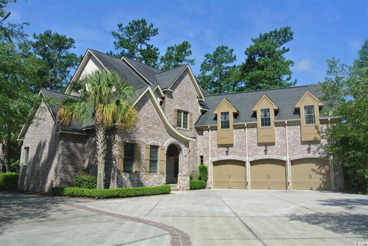 This amazing home is  located in Creek Harbour, which is a 123 lot Intracoastal Waterway Community (ICW), in the Horry County School district.      This home was built in 2006 and is all brick construction with stucco accents.  This home is situated on a large .83 acre corner lot with close access to the community amenity center/pool, neighborhood boat ramp and day dock with deep water access through Collins Creek that connects to the  ICW. There is a full service marina just minutes away.  The main home is a 4br/5 full bath with a bonus room over the garage that is   currently used a theater.  The bonus room could be a 5th bedroom with large closets and a full bath.   In 2007, a separate heated & cooled detached 3 car garage was constructed that includes a living room, bedroom and bathroom over the garage.   This home can accommodate up to 6 cars with plenty of room left a for storage.  Home details include crown moulding, double tray ceilings, cherry cabinets, stainless appliances, granite countertops, kitchen fireplace, a study/library with unique balcony over living room, Pella windows, carriage style garage doors, back yard patio with hot tub, enclosed rear porch, and many other unique features.   Creek Harbor is conveniently located near Publix, Lowe's Foods and two shopping centers. The beach, Murrells Inlet Marshwalk, and Brookgreen Gardens are just minutes away!  The Myrtle Beach International airport is less than 15 miles.   Call to schedule a private showing.