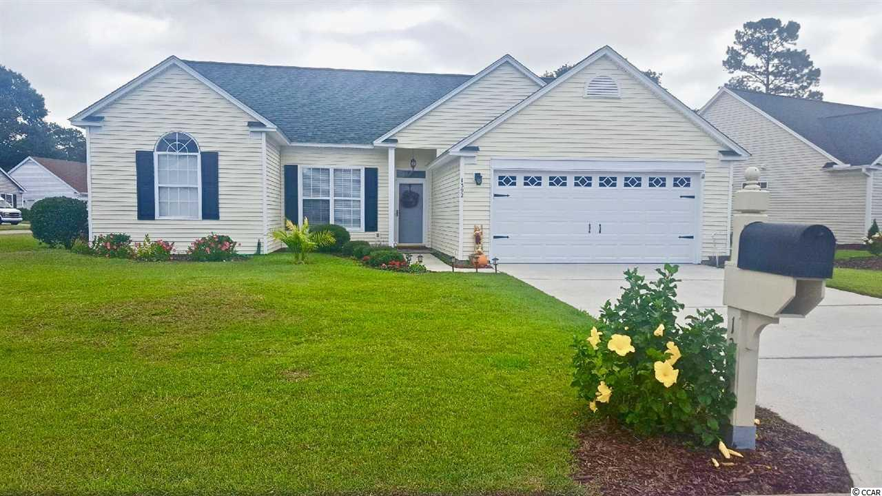 Welcome to this immaculate 2 bedroom 2 bathroom home located in the highly sought out neighborhood of Indigo Creek! Indigo Creek is a well established neighborhood with access to a community pool, deeded golf course with reasonable rates and a clubhouse offering several social events for community members! Indigo Creek is near the Murrells Inlet Marshwalk, doctors offices, hospitals, all shopping, dining, beaches and attractions along the Grand Strand! This home is situated on a spacious corner lot on the 18th tee of Indigo Creek and features 10 ft ceilings and several upgrades including new carpet in the master bedroom, 1.5 year old HVAC and Roof, paint, wainscotting, blinds, flooring, fixtures in the living room and kitchen, fridge, microwave, stove, as well as updated landscaping and an 8 zone irrigation system. This home also features a new garage door as well as attic storage above the garage! The bedrooms are very spacious each with their own full bathroom.  Don't miss out on this wonderful opportunity!