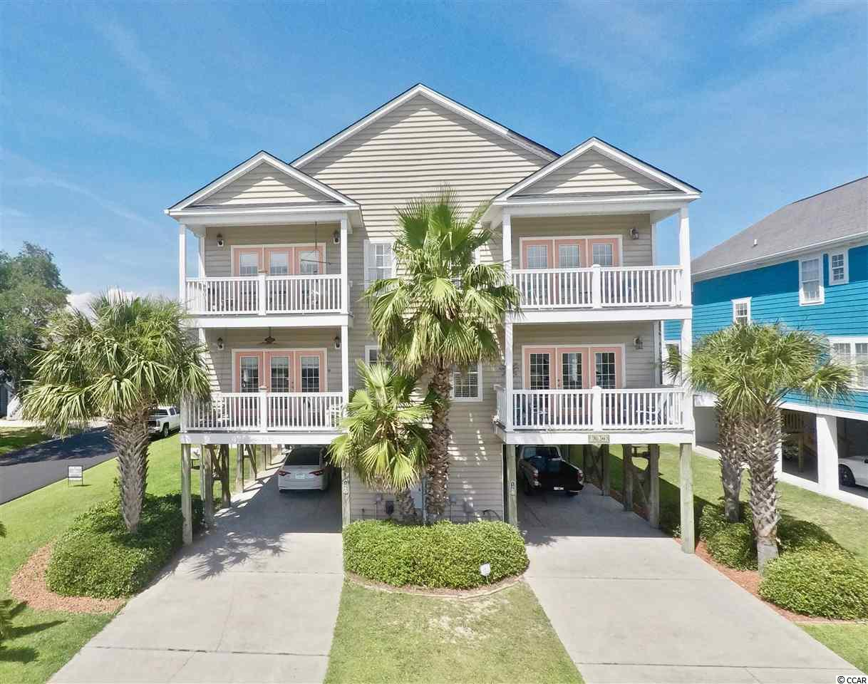 Multiple Offer Situation - best and highest by 3pm, Thursday July 22nd **  Welcome to this immaculate 5 bedroom 4 1/2 bath home located just steps from the beach in Garden City! This home features an onsite pool and ocean views from the decks! The home is spacious providing plenty of space for family and friends to relax! This home is located near all the Grand strand has to offer including golf, shopping, restaurants and several other attractions! Great rental potential as well!
