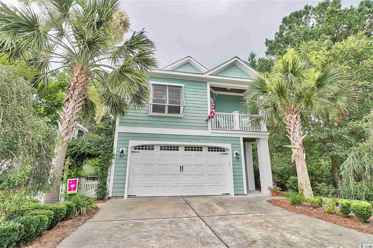 Welcome Home. This immaculate 3 bedroom 2.5 bath home sits on a lush, beautifully landscaped, private lot behind the gates of The Bays at Litchfield. Protected nature areas and walking bridges compliment this uniquely tranquil, private location. The home features a plethora of upgrades including a gas stove, plantation shutters, upgraded cabinetry, built-ins, crown molding, and so much more. A true split bedroom floor plan, the layout makes every day living and entertaining a breeze. Entry through the front door displays a private foyer and leads to the two spare bedrooms which share a full bath on the 1st floor along with a separate large screened porch. Upstairs, you will find the master suite with a private balcony, an open kitchen, living and dining space, 2nd screened porch and open deck for grilling. Convenient to everything Pawleys Island has to offer - shopping, dining and beaches.   Square footage is approximate and not guaranteed. Buyer's responsibility to verify.