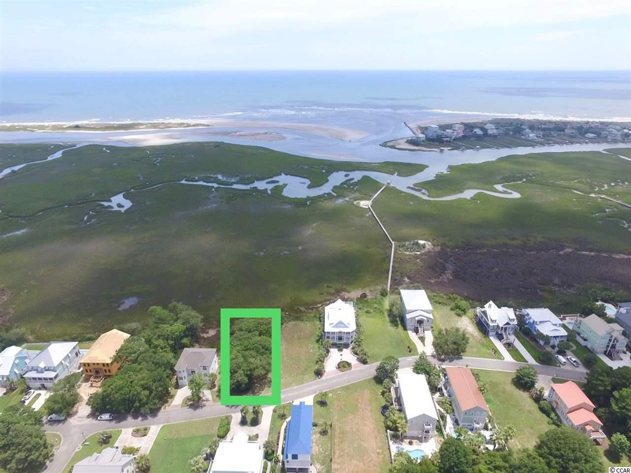 """""""Quite possibly the most beautiful vacant lot left in Pawleys Island! Unobstructed, breath-taking view of the Atlantic Ocean over the inlet separating Litchfield and Pawleys Island. Located in the sought-after, gated Sweetgrass Marsh community. Shared dock with private water access for kayaking, fishing & crabbing. Walk or bike to fabulous shopping, including The Hammock Shops and Fresh Market. Close proximity to banks, medical facilities, restaurants and world-famous golf courses. 20 minutes to historic Georgetown, 30 minutes to Myrtle Beach International Airport."""""""