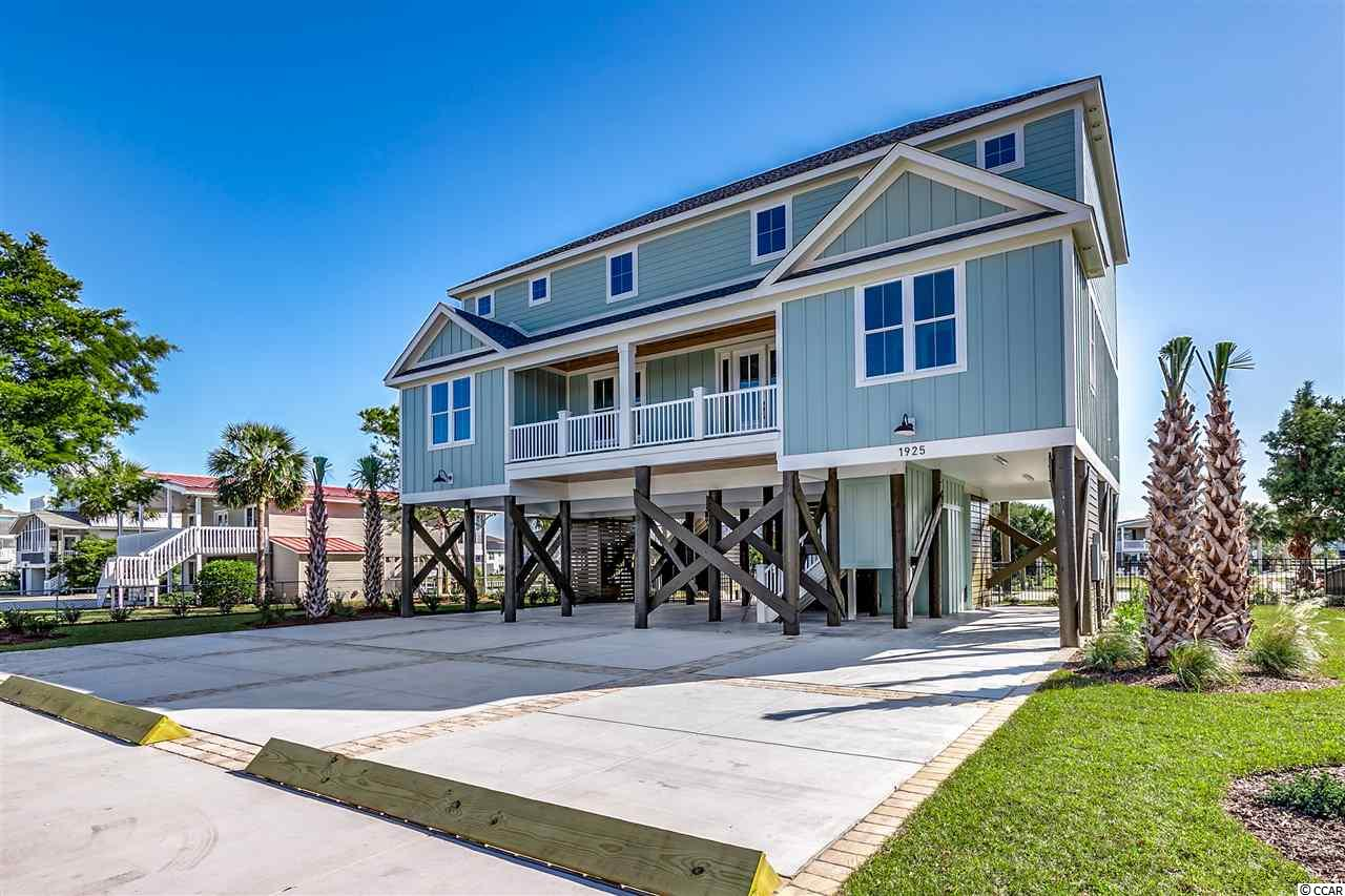 Just completed! This luxury home has creek front home offers (7) bedrooms , (6) bathrooms , an elevator , dock on the creek, new sea wall, in ground pool and much more! Lots of room for family and friends in this home AND could be a great investment !!! Built by Beverly Homes- the Grand Strand areas premier customer builder, there is no detail left out. Truly a one of a kind property.