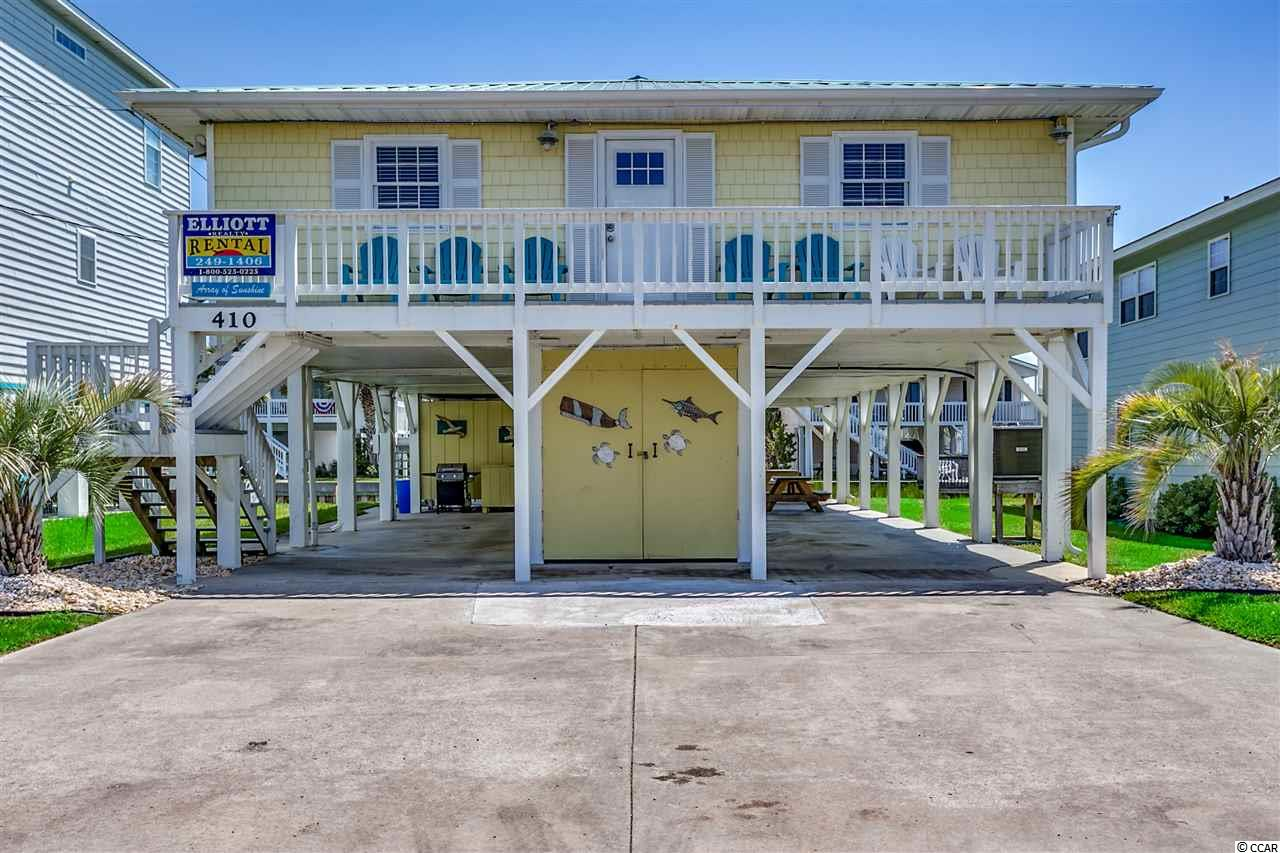 """Welcome to """"Array of Sunshine""""!  A charming beach cottage located on the channel in the ever popular Cherry Grove section of North Myrtle Beach.  This is not your typical channel home; fully transformed with multiple upgrades and renovations in 2017.  The home comes as a turnkey property, fully furnished and includes all decor, electronics and appliances.  While this is a channel home, it is NOT subject to the Cherry Grove dredging assessment.   A classic floor plan features 4 bedrooms and two jack and jill baths.  Large spacious living area that opens to a dining and bar space.  All drywall was replaced and new electrical outlet boxes and switches installed.  Walls have been freshly painted in decor colors. Lighting was changed to LED throughout along with new ceiling fans and light fixtures.  Both bathrooms have an upgraded spa feel and were completely renovated with new tile, plumbing fixtures, toilets and vanities.  The kitchen has a bright look with new tile flooring, white cabinetry and new stainless appliances.  Large bar space perfect for large gatherings.  Array of Sunshine has an upscale, designer feel and all decor was personally selected by the owner. Furnishings and decor were purchased new in 2017 and the home is set up to accommodate larger groups; perfect for a vacation rental property or a large family.  Secondary bedrooms are spacious; each with one queen and one full bed.  They also include a built in vanity and dresser space to maximize space.  Other upgrades include new HVAC, hot water heater and entry doors.  The outside space of this home is meant for maximizing the coastal lifestyle!  Large front and rear deck space; the rear deck has new vinyl railings.  Open breezeway under the home and a great channel and marsh view.  Large two stall outdoor shower and changing room space.  There's a fixed deck over the water with new decking and walkway from the backyard. Enjoy a low maintenance exterior with vinyl siding, new shutters and gutters.  The r"""