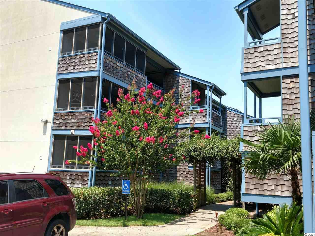 Beach décor and move in ready, beautiful tiled flooring walks you into a Great opportunity to own a spacious open floor plan two bedroom, two bath condo in close walking distance to the beach.  Third floor- woodsy private view from either an open balcony or screened in porch.  Fully furnished and inviting, just bring your clothes and a toothbrush.  Each room has its own generous space and the screened in porches just add more.  J building sits beside the indoor pool for a convenient walk over the complex offers a large outdoor pool as well, along with picnic tables and outside grills for some summertime fun.  You are only a short drive or walk to a large variety of restaurants, numerous golf courses, loads of family entertainment and shopping.   Make this your primary home, vacation spot or investment