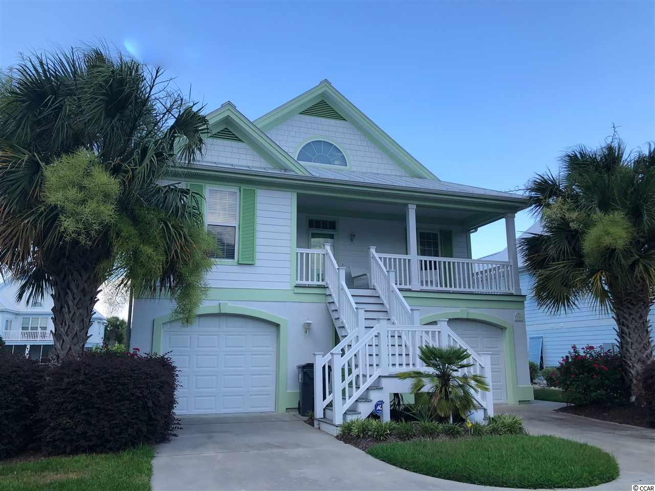 Never Rented! What a gorgeous and HUGE home near the ocean. Oceanside Village has its own gated beachfront access, with a bathroom and gazebo, next to the Conch Café. Imagine going to the beach by golf cart, lunching on the porch of the Conch with a divine ocean view, returning to taking a dip in one of the two community pools, and having a raised beach home large enough for the whole family! Bermuda Bay is a beautiful neighborhood inside Oceanside Village. The pastel homes are stately, and this home boasts five bedrooms, four and a half baths. The downstairs could be a separate apartment for mother or guests, or rentals, since it has its own kitchen, living/dining, two bedrooms and large bath. Upstairs, you find a huge master suite, another master suite, and a kids' room with bunkbeds, a twin and a sofa. The kitchen is open and airy and connects to the dining area. The neighborhood has a giant community center, with fun activities, tennis, bocce ball, pickle ball, playground, dog park, and much more. Lakes and green areas are found all around the community. You will love the fitness center and library. Don't miss the chance to buy into this lifestyle! This home is beautifully and elegantly furnished. Ready for you to enjoy...