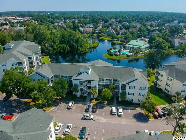 "Pristine, top-floor condo in elevator building with gorgeous views of sparkling blue lake, fountains and nature. This beauty features 12' Vaulted Ceilings in living area and a 10' Tray Ceiling in the master bedroom contributing to a bright, open feel throughout. High quality, 7"" plank  laminate wood flooring in all living areas.  Light, neutral walls and beautiful french doors accent the view of the lake and allow plenty of natural light to enter. Attention to detail including installation of elegant pendant globe lighting over breakfast bar and updated faucets and other fixtures lend to the contemporary feel of the interior. Expertly maintained including installation of new Bosh dishwasher (conveys with warranty), hot water heater and microwave in 2019.  Ocean Keyes is a gated community just two and a half blocks from the beach. Situated just a block from Main Street, it is in the hub of all the fun and activity synonymous with North Myrtle Beach and Ocean Drive including the heart of shag, restaurants and night life. The community is renowned for its onsite amenities such as full fitness facility, tennis courts, outdoor pools with sunning patios, hot tubs, built-in Bar-B-Que's, club house/recreation center, walking trails and more. The fitness center and in-ground, heated pool are just steps away. It doesn't get any better than this!"