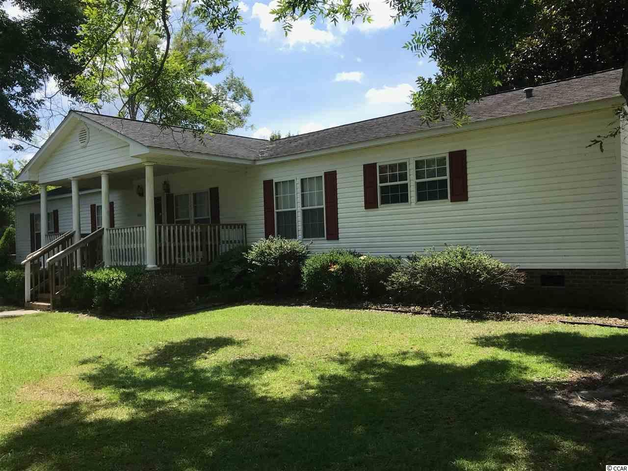 Wow! This is a MUST SEE! You will love this property nestled in the historic town of Conway,SC. Talk about living in the country but only being 18 miles away from the beach! Situated on 5 1/2 acres, this home comes with 3 separate addresses .There is 800 sq. ft. combo garage and workshop with plenty of parking for friends and family. The entire property is fenced in and has 5 separate septic systems in which 3 are DECH approved along with county water and underground utilities. The main house sits on 1 acre that offers 3 bedrooms, 2 full baths and  a half bath. The living room which is off the main kitchen has a nice fireplace, and there is an office which could be used as a fourth bedroom. There is a studio kitchen with a 28 x 10 utility room which includes a washer and a dryer. All appliances stay. Imagine eating breakfast in your 20 x10 Carolina Room that also has a 26 x 10 screened in porch leading to a patio. There is also an old horse barn and tack house on the property that could also be restored with some TLC. I just can't say enough about this property! What are you waiting for? Call me today to set up a tour.