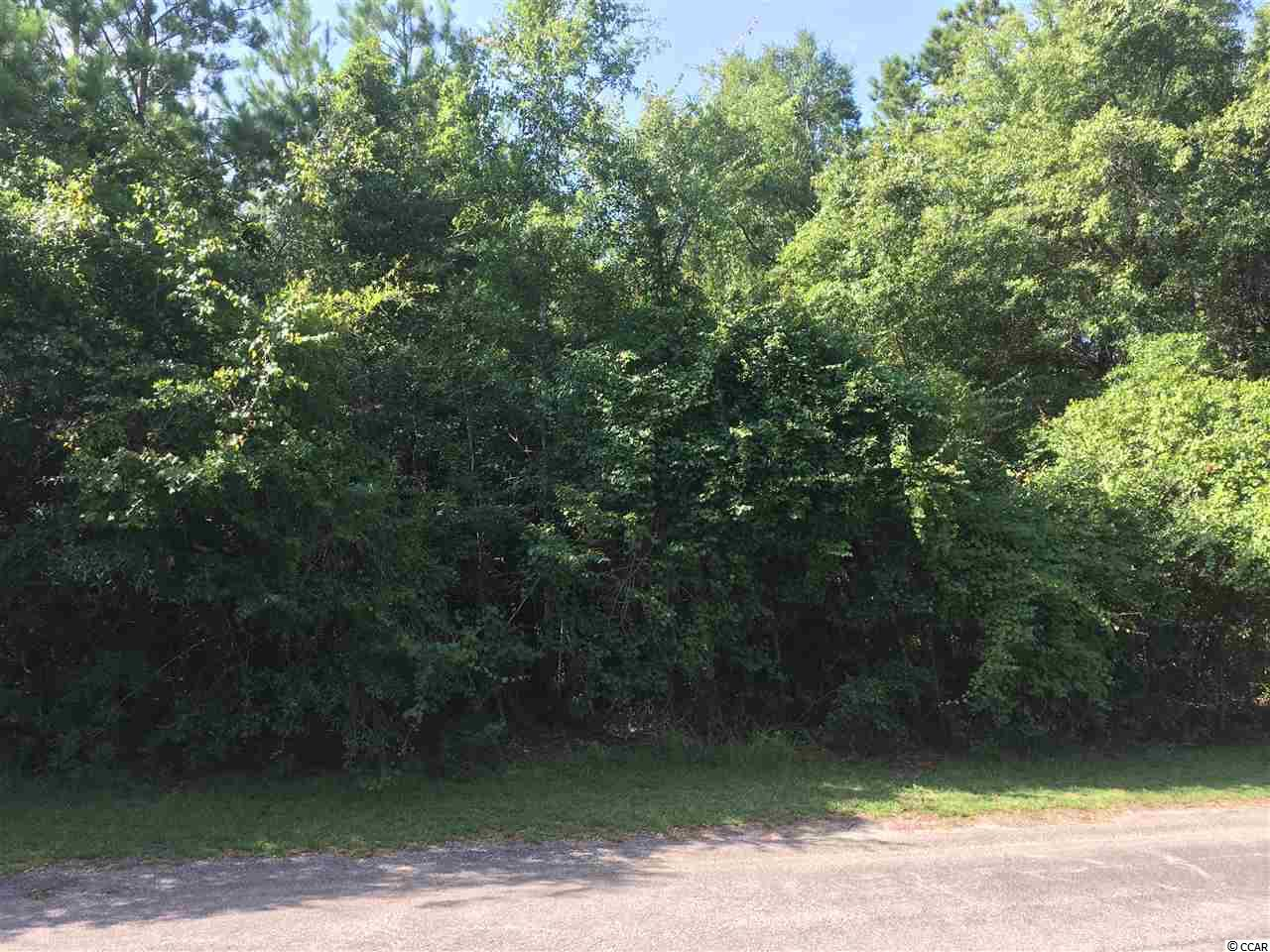 THIS LOT IS READY FOR A NEW HOME WITH A LITTLE CLEARING AND DREAMS CAN COME TRUE.  OWNER WILL PAY FOR A PERC TEST UPON ACCEPTABLE CONTRACT.   GREAT NEIGHBORHOOD FOR BOATING, GARDENING AND RELAXATION.  JUST AROUND THE CORNER TO THE BROWNS FERRY BOAT LANDING.  GREAT PRICE AND NO HOA FEES.