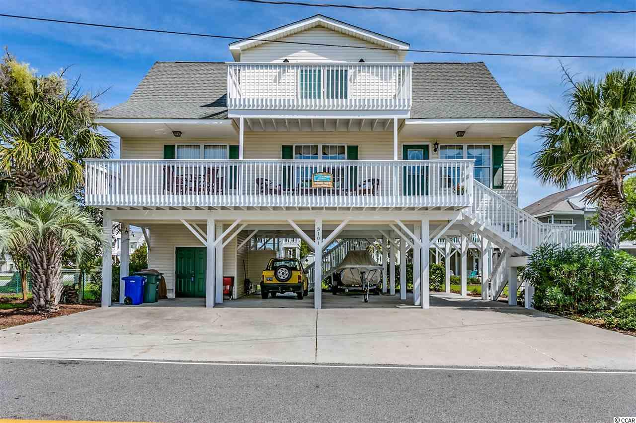 Come check out this very well maintained beach home located just a few short blocks from the ocean in Cherry Grove.  This spaciously designed floorplan features an open layout with great room, dining area and open kitchen.  There are 2 spacious bedrooms on the first living level and a private master suite on the top floor.  Lots of parking underneath the home and even a golf cart garage/store room/workshop downstairs.   The location is ideal and is only 1.5 blocks to the beach, 3 blocks to the Cherry Grove Pier, and only about 7 blocks to restaurants, grocery, shopping and more. Don't miss this one!