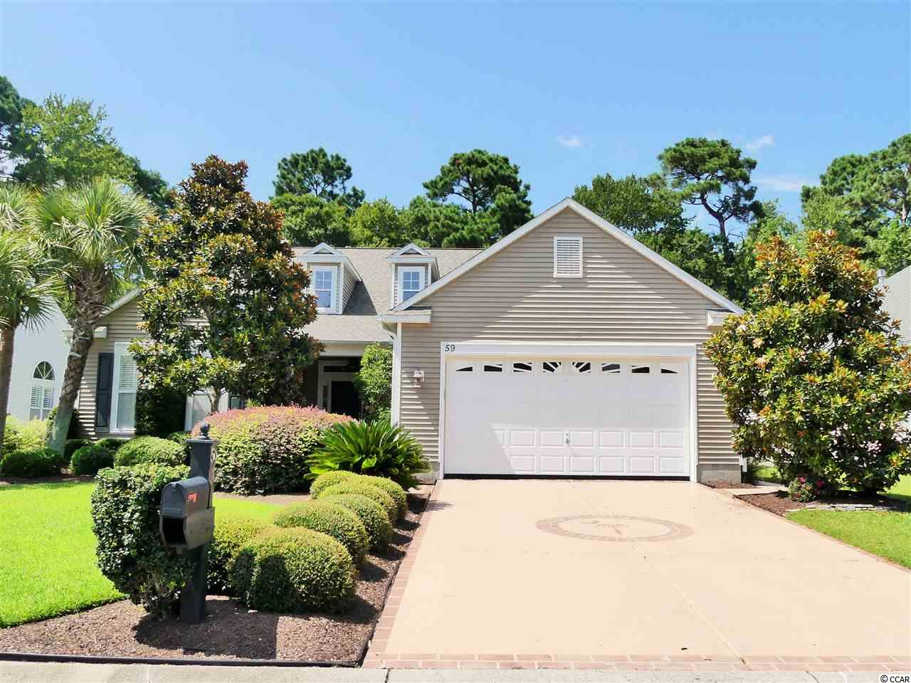 Incredibly well kept home for sale in Murrells Inlet, SC situated along Prince Creek Parkway in one of the area's most sought after developments. 59 Long Creek Drive boasts lush landscaping, almost 3,500 total square feet, a plethora of upgrades, and a flowing open floor plan !