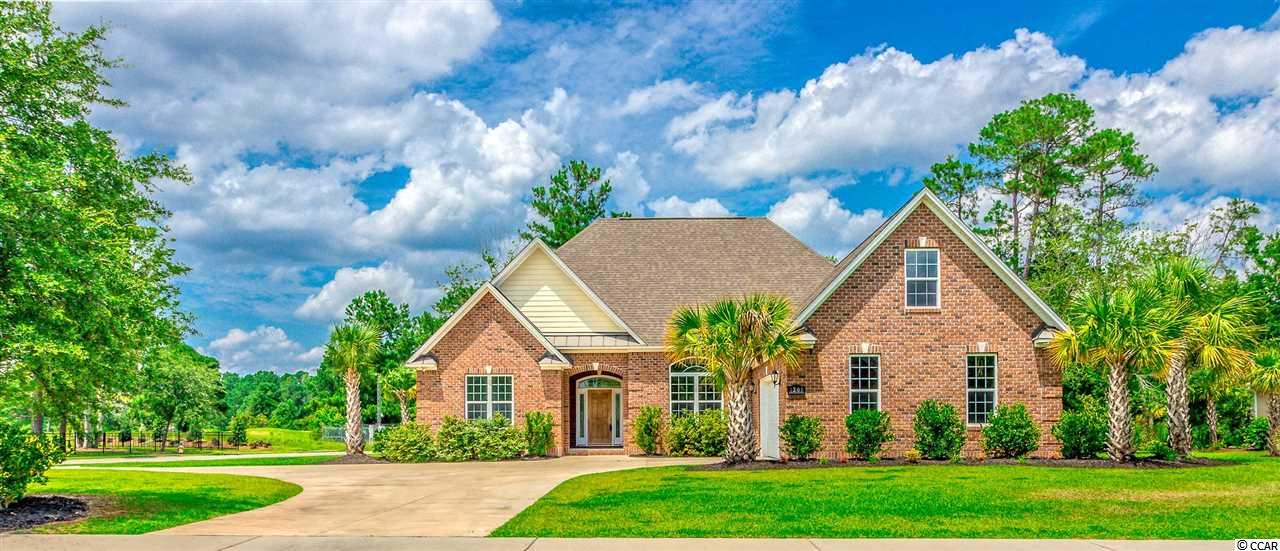 Immaculate 5 bedroom, 3 and a half bathroom home on a corner lot in the highly sought after Wild Wing Plantation golf course community. From the moment you walk in you will notice the open floor plan with an abundance of windows allowing natural light to flow through the home. Tray ceilings and crown molding are found throughout this gorgeous house. The elegant kitchen will bring all of your inner chef dreams to life with 42' staggered cabinets with lighting underneath, and a tile backsplash above the granite counter-tops with all stainless steel appliances. A breakfast bar also features beautiful custom tile accent on the outer side. This home features a split bedroom floor plan, with 3 bedrooms on the first level of which 2 are connected through a jack and jill bathroom. The master bedroom boasts illuminated tray ceilings and leads to a luxurious master bathroom with a grand walk-in closet. Master bath features a double vanity, oversized-fully tiled shower, and a whirlpool bathtub. An additional 2 bedrooms can be found up the stunning wooden steps featuring iron rails. Upstairs bedrooms with a full bathroom would be perfect for a play/game area, or an in-law suite, the possibilities are endless. You can also enjoy plenty of time on the covered back porch that extends the entire length of the living room and kitchen with an additional extended patio. The porch has beautiful pine ceilings with large brick pillars and 2 ceiling fans to keep cool. The over-sized 2-car garage and large driveway will be sure to accommodate all of your guests. The Wild Wing community offers a clubhouse, outdoor pool, tennis court and golf within minutes of your front door. Conveniently located to all main highways, a wide range of dining options, shopping, CCU, HGTC and of course the gorgeous Atlantic Ocean! Measurements are not guaranteed and are the buyer's responsibility to verify.