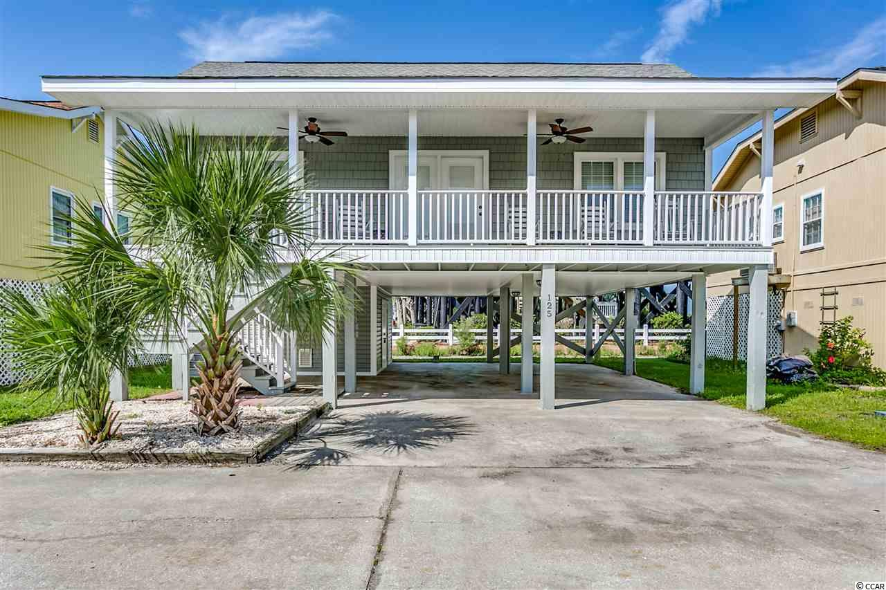 This Beach Home offers a 5 minute walk to the sought after Garden City Beach and has been kept in exceptionally great condition. This will be a great rental if one chooses. However this owner only used it for second home and very little. This Beach Home Exterior boast Architectural Shingles, New Windows, New Vinyl including Metal boxing. The 12 x 14 Storage beneath this Pier Home has New Steel Double Doors for easy access for Beach Toys and/or Golfcart ect (no golfcart included). New Porch Rails with Painted steps to enter home thru New Double Door (with Built in Blinds). New Exterior Steps with New Landing for an entry to Kitchen side entrance thru the New Storm Door with New Door (with Built in Blinds). This Beach Home Interior boast Freshly Painted Smooth Ceilings, Interior Walls and Doors. The Updated Kitchen has New Flooring, New Counter Tops, New Farm Sink and Delta Faucet. Along with New Stainless Steel Appliances.