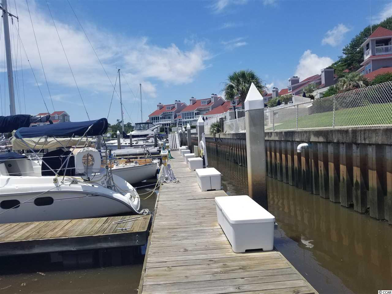 Closest 40' slip to the Little River Inlet!  Floating docks with water and electricity at the slip!  Great amenities include clubhouse, year round pool and spa, showers, etc.  Slip location is just off the pool and clubhouse!  Has Dock locker and convenient parking.  3 bedroom townhouse/condo with ICW views also available!