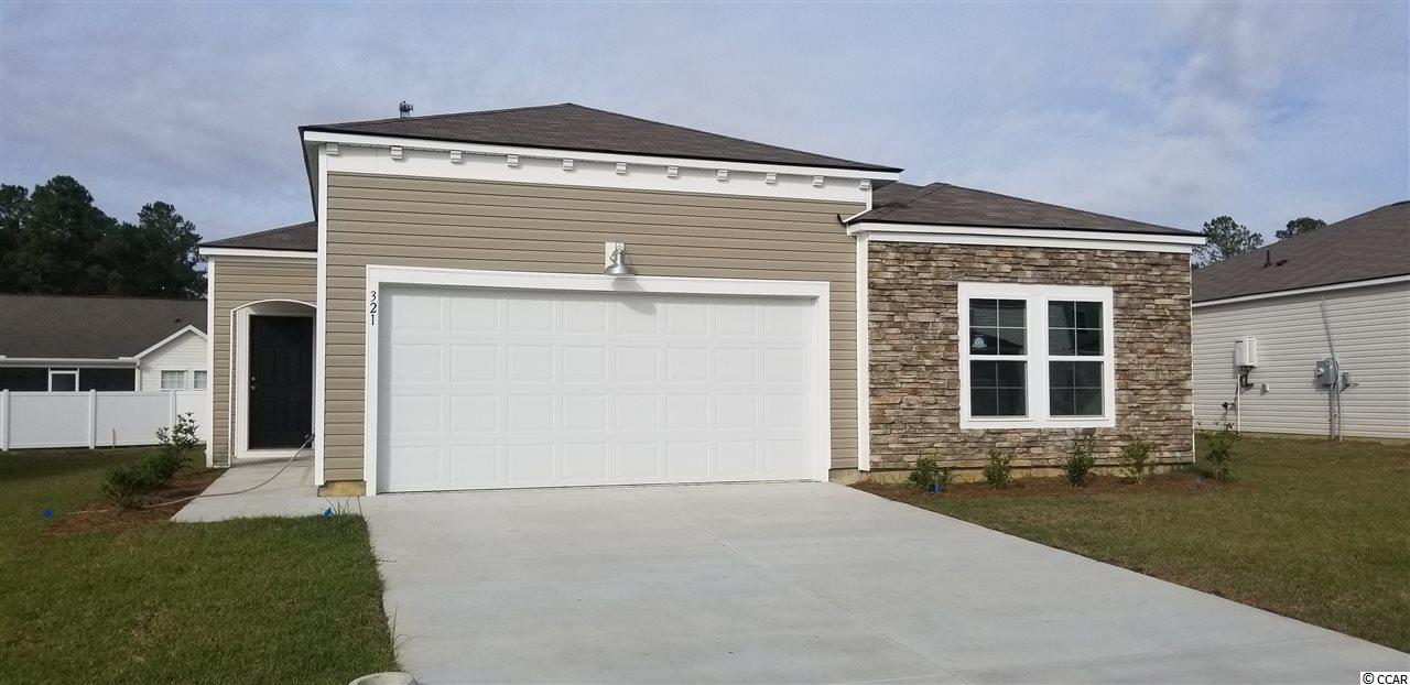 "This Harrisburg floor plan features 4 bedrooms, 2 bathrooms with a substantial  sized Owner's Suite and oversized walk in closet. This open concept home hallmarks 36"" stylish white cabinets, 3 x 6 subway tile back splash and granite in the kitchen, Shaw luxury vinyl plank flooring in the main living areas, Frigidaire stainless steel appliances including a gas range, Dishwasher,and Microwave/Range Hood. The Owner's suite bathroom highlights double bowl sinks, elevated vanity, and 5' walk in shower. This home also features  LED recess lighting, Moen faucets and towel hooks, elongated toilets with soft close lids, and a Rinnai tankless water heater. Pictures are of a previously built home and are for illustrative purposes only."