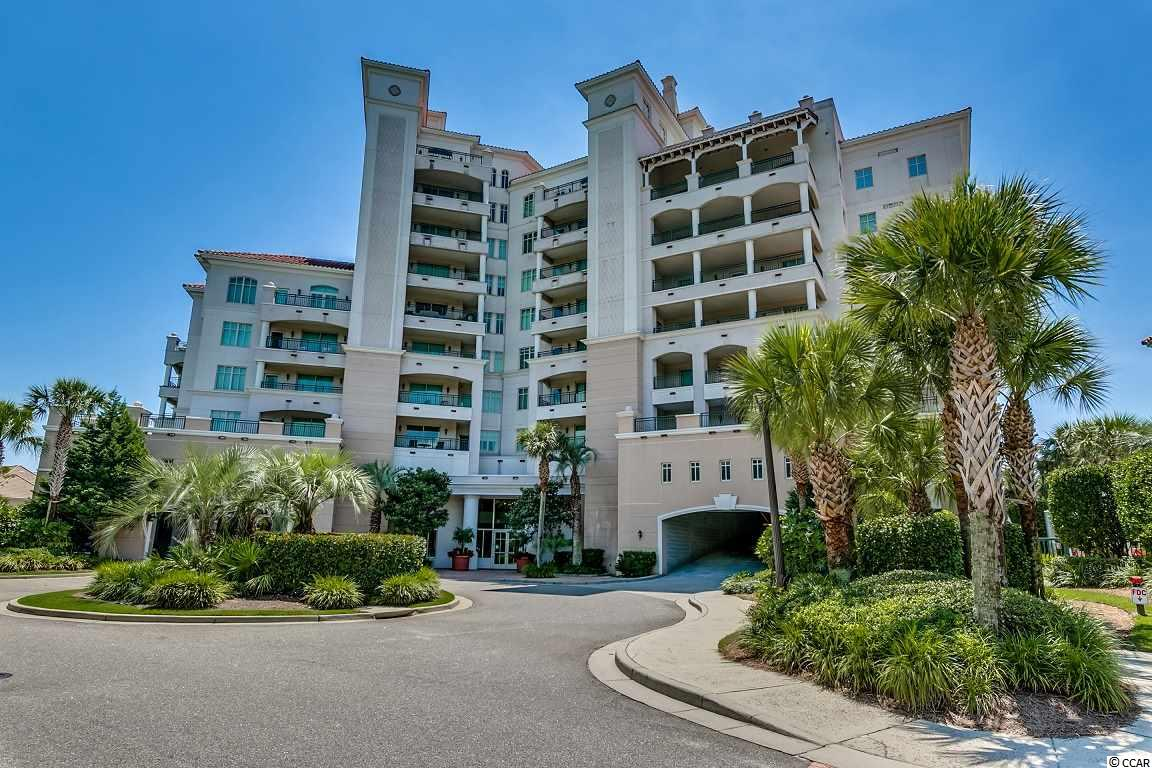 Very unique 3 BR / 3.5 BA PENTHOUSE with total panoramic views!  2 Master suites plus a den.  Everything was put in new in 2018 from walls, to cabinets, appliances, AC unit, upgraded water system . . . lots of upgrades.  Private exclusive gated community located direct oceanfront in Grande Dunes.  Elevators will take you directly into unit.  Amenities include pool and fitness room, outdoor covered eating area with grills, 2 assigned parking spaces, private beach access and private Ocean Club membership.   NO short term rentals allowed.