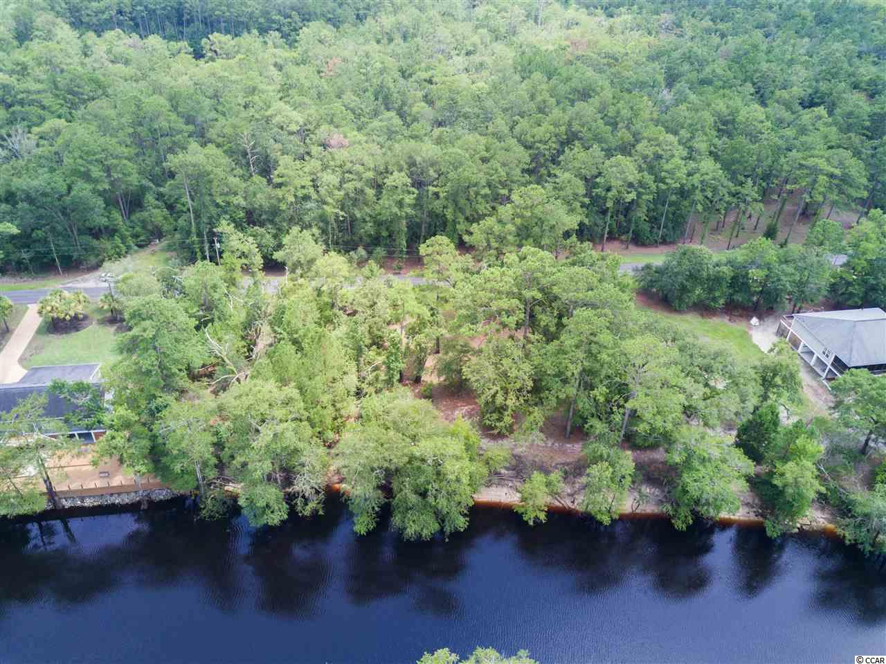 Are you looking for a quiet place to build your dream home? Not only could you build your dream home on the Waccamaw river you would also be surrounded with widlife.  This lot would be perfect for someone looking to be just 20 minutes from the beach, but also have your privacy at the same time.