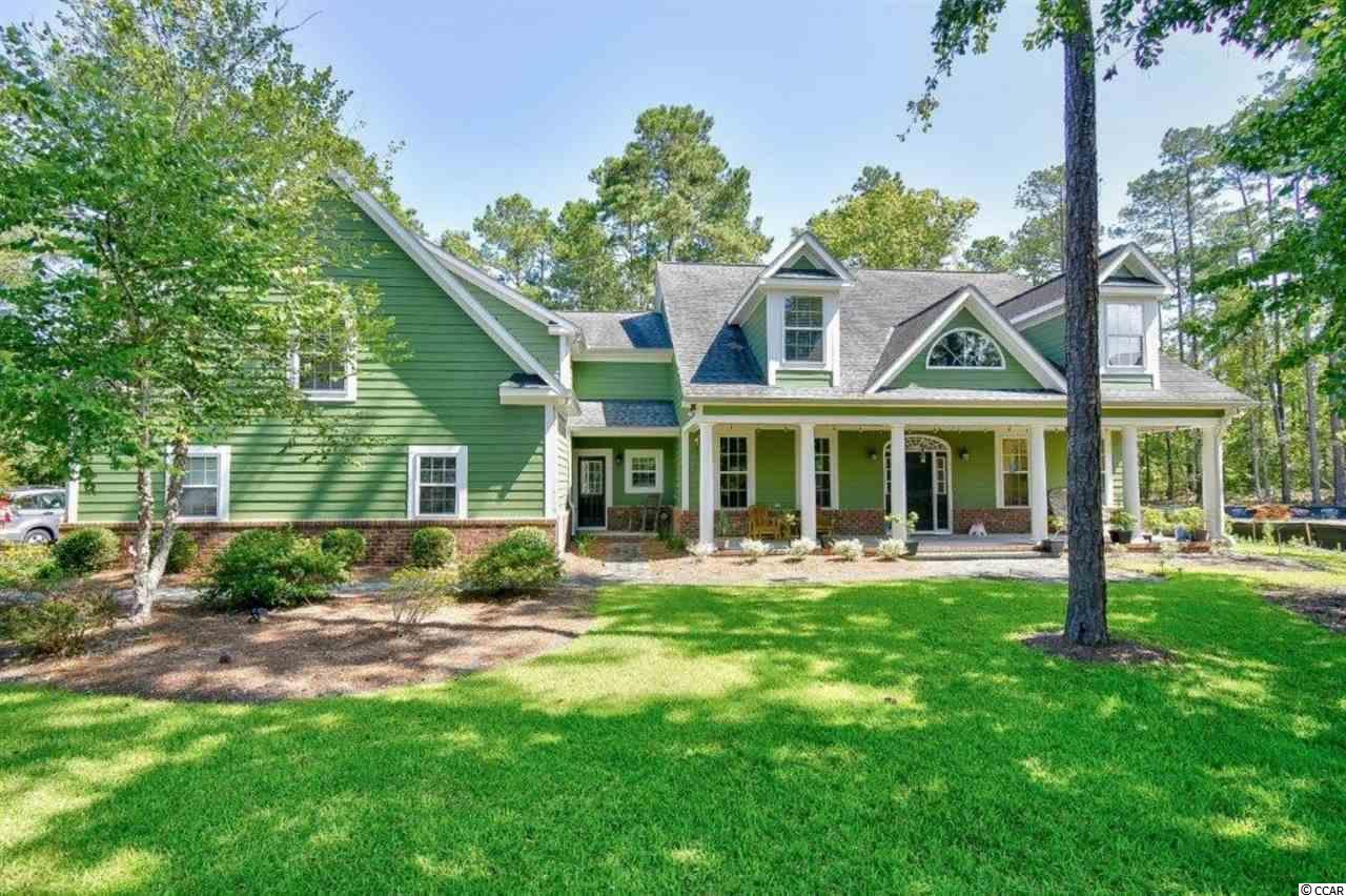 If you're looking for lots of indoor and outdoor living space, privacy, a huge fenced in back yard all inside a Gated Waterway Community you'll find it all at Moultrie Circle.  The home is located in the middle of a cul-de-sac on a huge on a .76 acre lot that backs to woods.  There is a long paver driveway perfect for kids to play or learn to ride their bike.  The park like front yard adds to the curb appeal of this Low Country Charmer. Walking in you'll find a large formal dining room to the left and an office/bedroom/flex space to the right (currently set up as a playroom). Moving forward through the house you'll find the family room which flows directly to a large open kitchen with Center Island and stainless steel appliances, with granite counters, and 42 cabinets, and a large pantry.  There is a ton of storage in this home.  The home has beautiful hardwood floors throughout the lower level, tile in the baths and carpet in the bedrooms.   Off of the kitchen is the laundry/mud room area with room for all of the coats, and hats, and shoes to be stored out of the main living areas.  This area also has a back staircase that leads up to the Master Suite on the 2nd floor.  This sanctuary of a master bedroom has a main living area and another area that can be used as a sitting room a spectacular second floor suite allowing for a romantic, private balcony where you can have a glass of wine with your spouse and listen to the crickets chirping and watch the sun rise or set . There are his and hers closets a huge master bath with granite counters, tile walk in shower and separate soaking tub.  Crossing the walkway to the other side of the home you'll find 3 additional bedrooms.  Two of the bedrooms are jack and jill style and have lots of room for the guests or kids to spread out.   Return to the main floor via the main stairway and head out back to the massive screen room that overlooks your back yard with plenty of room for a pool if you'd like.  The screen room/deck are
