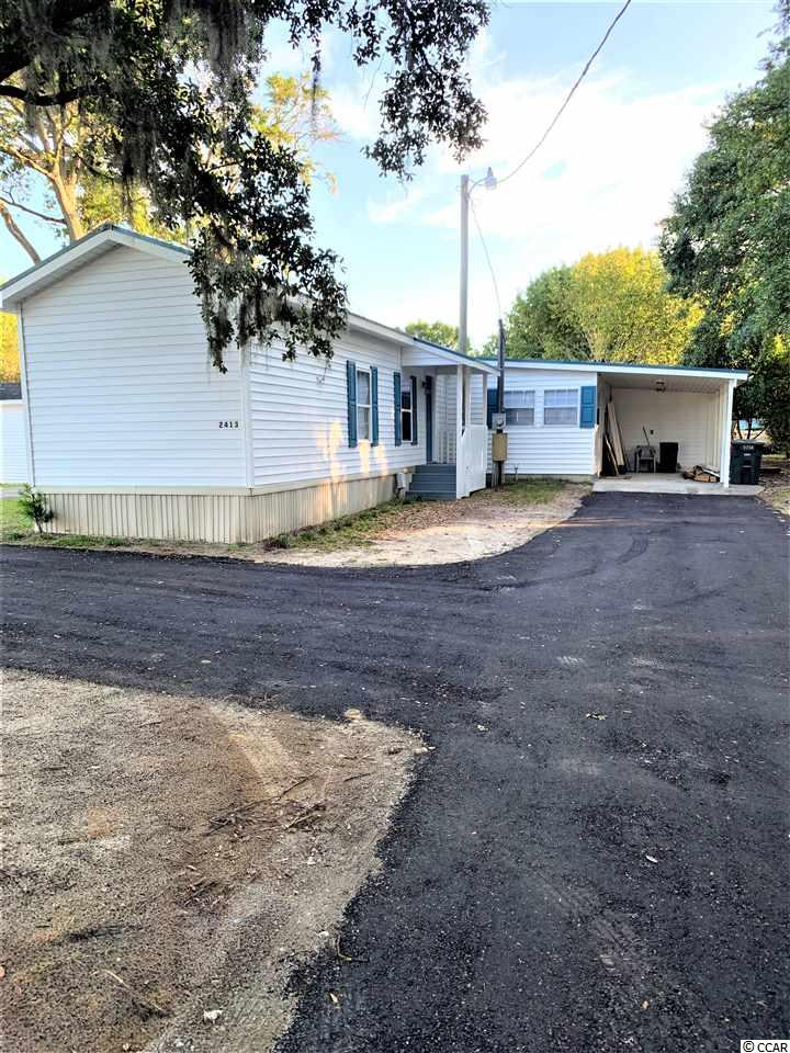 Nice freshly remodeled single wide mobile home with 2 room additions on deeded lot, close to everything Cherry Grove has to offer. 1.4 miles to the beach, 4 blocks from the ICW. Golf cart ride to Beach, shopping, restaurants and more.
