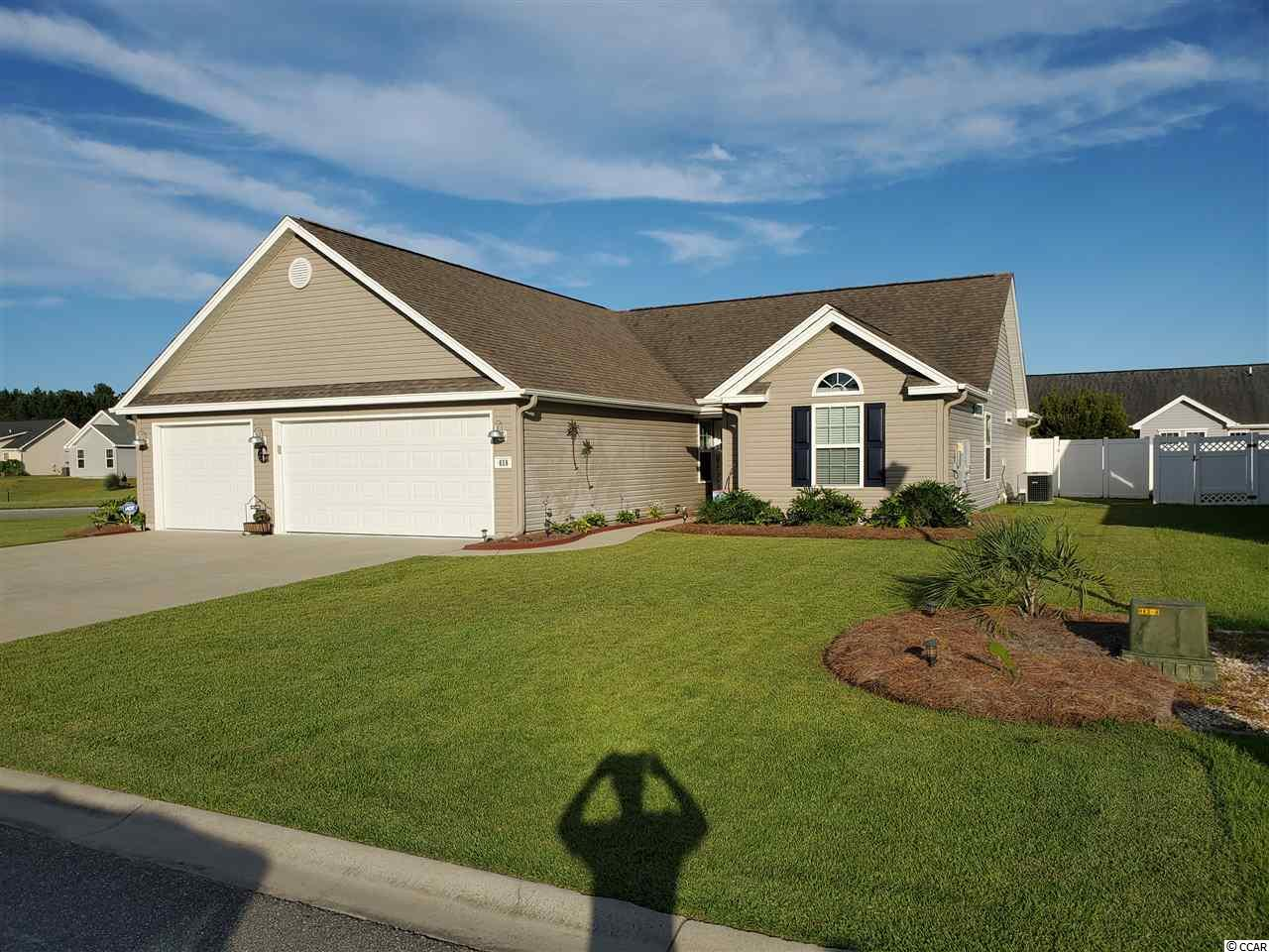 """Are you looking for extraordinary, stunning, one of a kind?  As the name implies, 618 Leprechaun Lane, Murrells Inlet is magical.  Built in 2011 and remodeled in 2018 with all the care and thoughtfulness of comfort and pleasure.  On the outside, a 3 car garage with the potential for a full kitchen and playroom (man cave) in mind. Or just ample parking for you and your guests. The walk in closet and luxurious shower in the master suite combined with the upgraded kitchen amenities and cabinet space add character to the home.  Tile in the main areas, with both vaulted ceilings and fans, with carpet in the bedrooms for warmth.  A kitchen dining room set up with an extra dining area for all occasions.  Cabinetry and appliances are upgraded as are all the plumbing fixtures, all of which are elegant and modern.  The Carolina room has a """"barn-door"""" enclosure for both privacy and additional space in the living room.  For those who love the outside, a well manicured yard with rain bird irrigation system.  Do not forget that outside shower for after the beach, a plus for keeping sand out of the home. 10x10 matching storage building in back yard. Extended patio for entertaining or BBQ. Storm and screen doors along with smart technology with remote access for the garage door and Nest for smart home capabilities. Ceiling fans in every room. There is ample storage in this house and a pull down attic with a huge room above the 3 car garage. You will not see a home that is in such pristine condition. Just a few miles to the beach, and a great St. James school system, to send your kids.  The home is tucked into a quiet corner lot with a 6 ft privacy fence with room to spare.  Let us not forget the insurance costs, while you are close to the beach, you are in a """"no flood zone"""" and west of By-Pass 17 which lowers your total cost for wind insurance.  A must see for anyone looking for elegance, convenience and ease of living in a and charming neighborhood. Call today and get your slice o"""