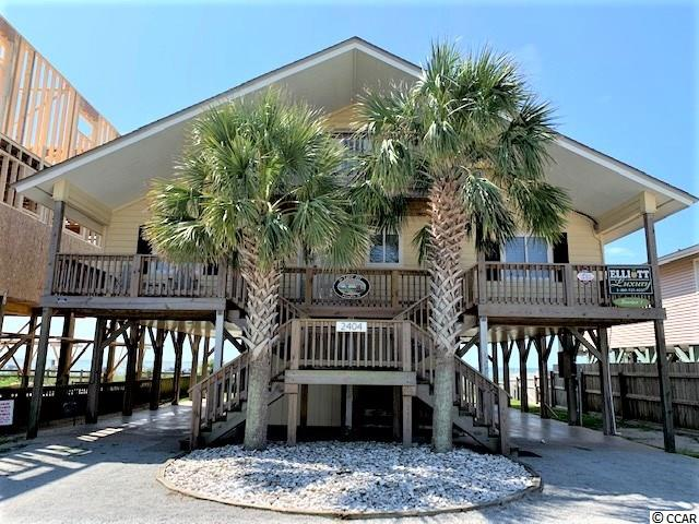 This is the ultimate prime oceanfront location in Cherry Grove!  The ocean is your backyard in this five bedroom, 3 full bath home with updates and upgrades galore!  Located just one block from Sea Mountain Hwy, you can walk to the grocery store, multiple restaurants, hardware store, beach stores, ice cream shops, entertainment and more.  Enjoy the beach scene from one of two oceanfront decks, just replaced in 2016.  The light, open floorplan has plenty of space for entertaining.  Easy to care for tile flooring on main level.  There are 3 large bedrooms downstairs, and two full baths. Master bedroom is on the main level and separated from the other two downstairs bedrooms for privacy.  The kitchen features stainless steel appliances, prep sink, and large center island.  Gorgeous plantation shutters on all downstairs windows.  The upstairs has 2 more bedrooms and a full bath, with one bedroom having a private, ocean front deck, and another upstairs deck on the street side.  This home comes furnished with new living room furniture just one year old and beautifully appointed bedrooms.  During the current ownership, there have been extensive updates to wiring, plumbing, windows, kitchen, bathrooms and more.  New roof in 2016, all four decks replaced, new tile, and the list goes on.  Call for details and to schedule your showing today!