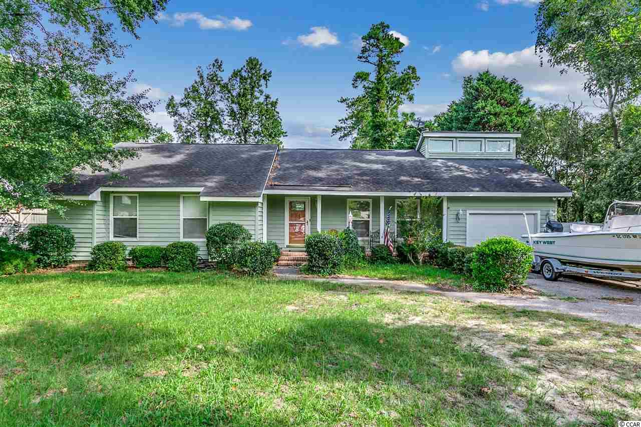 Comfortable and Cozy 4 bedroom, 2 full bath home with an open floor plan in the Palmetto Shores Community with NO HOA fees! Home features include crown molding, Pergo floors in living and dining room, tile in baths and kitchen, eat in kitchen with bay windows overlooking large fenced in backyard.  This affordable home would be ideal for a primary residence or vacation getaway! Great location only two blocks form the Intracoastal Waterway with public boat ramp and only a short golf cart ride to the beach!  Don't miss out on this amazing opportunity, at this price it will not last long!